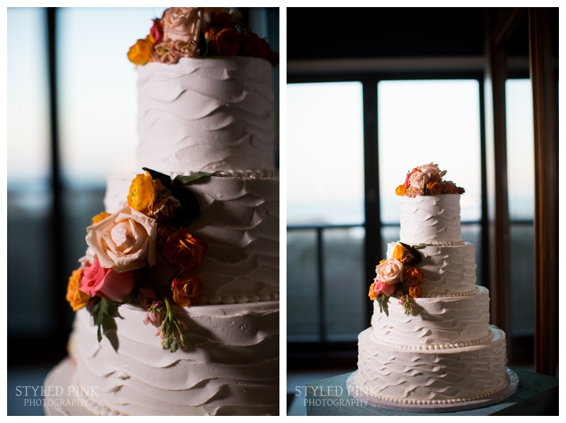 The gorgeous wedding cake by Stella Baking Company sat by the window overlooking the ocean.