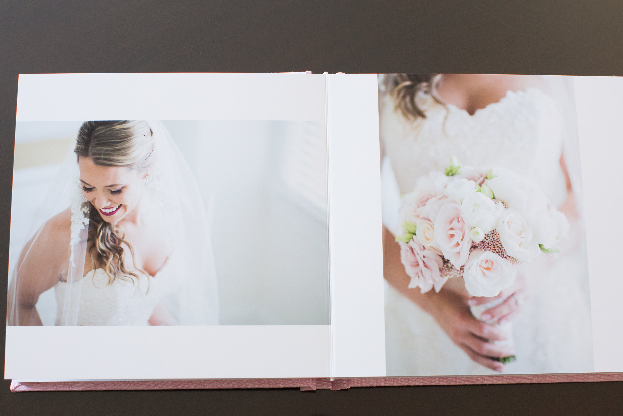 I love how the image of Amanda's bouquet bleeds to the top and bottom of the page. When it comes to photos in an album- the bigger the better!