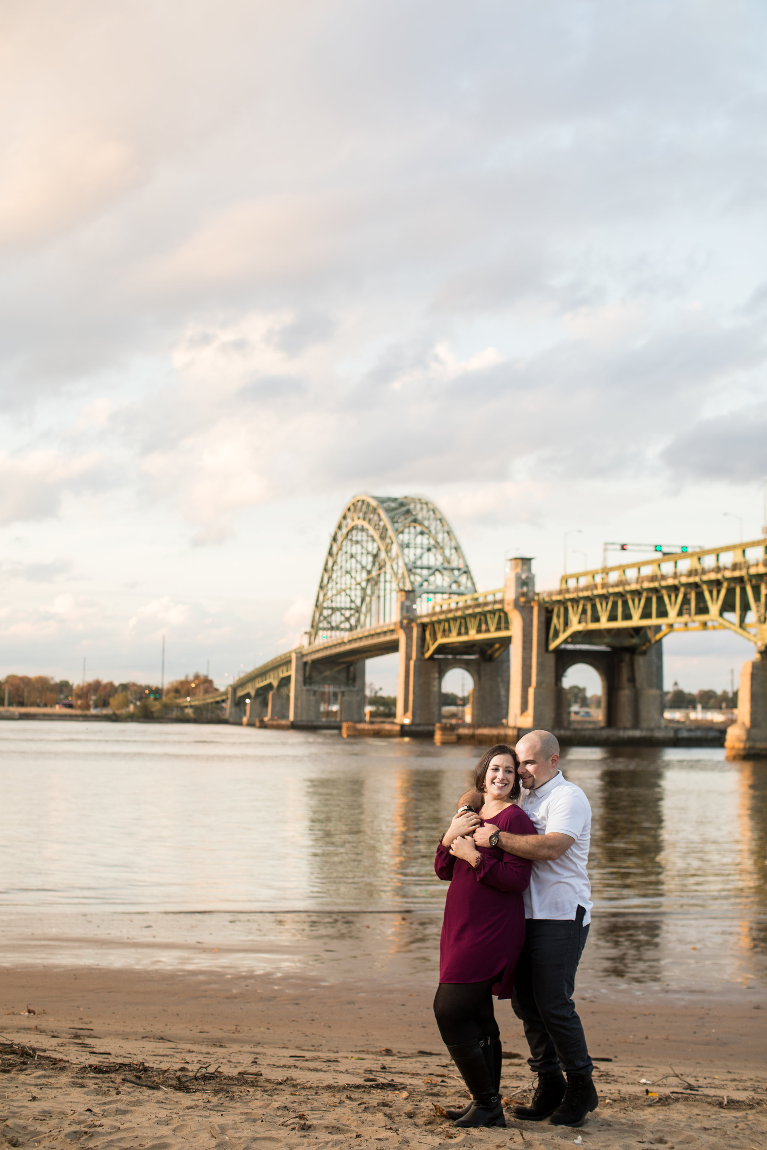 Jamie and Pete snuggle up for an amazing sunset near the Tacony-Palmyra Bridge leading into Philadelphia.