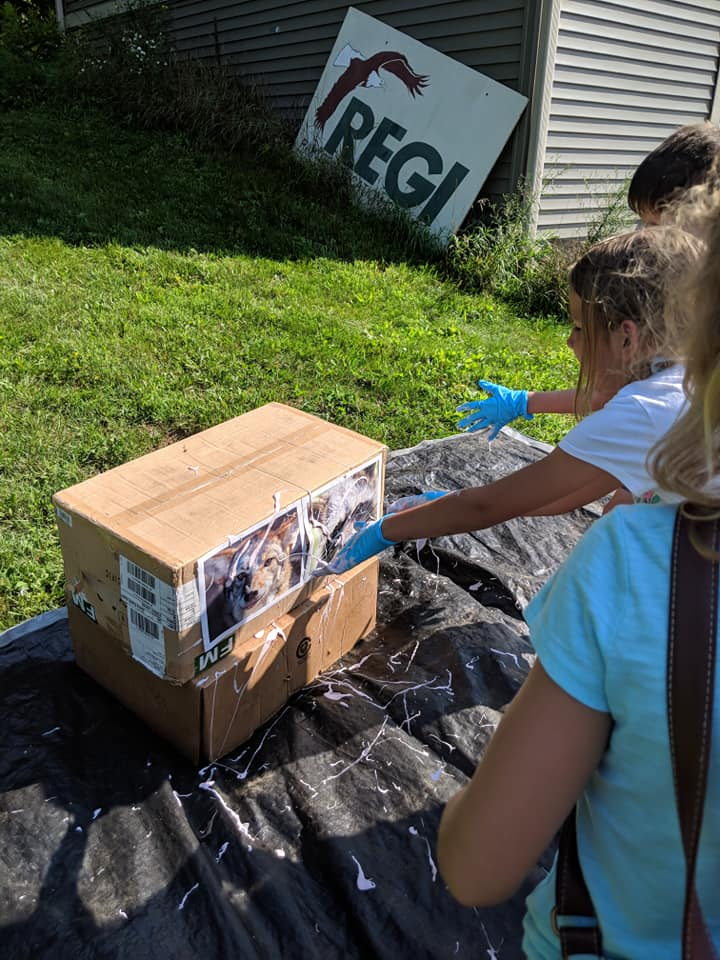 "During this station campers learned about the turkey vulture's most infamous defense, PROJECTILE VOMITTING! Children threw ""vulture vomit"" (slime) at images of possible vulture enemies."