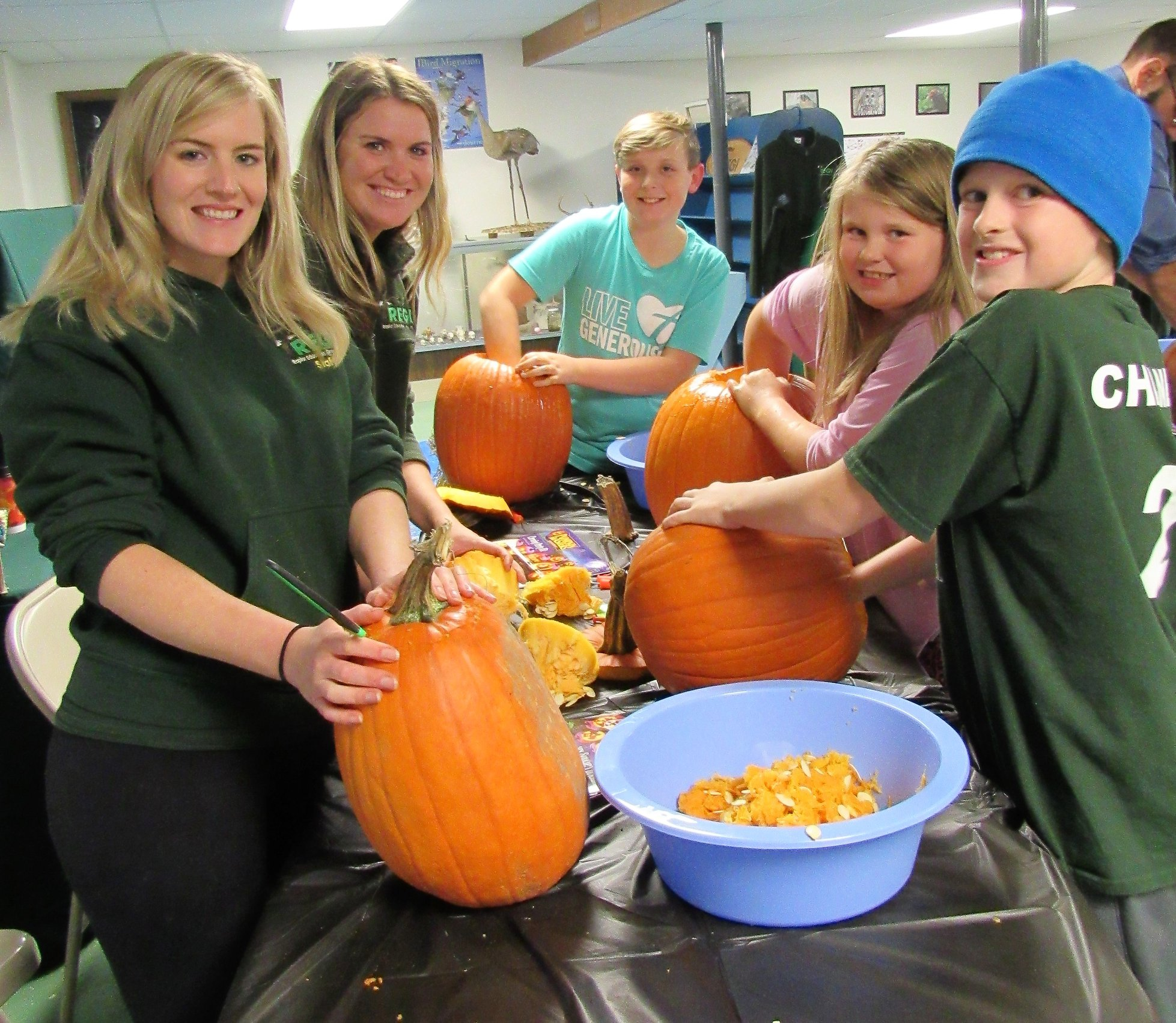 Cleaning out the pumpkin seeds for our crows, ravens and staff!