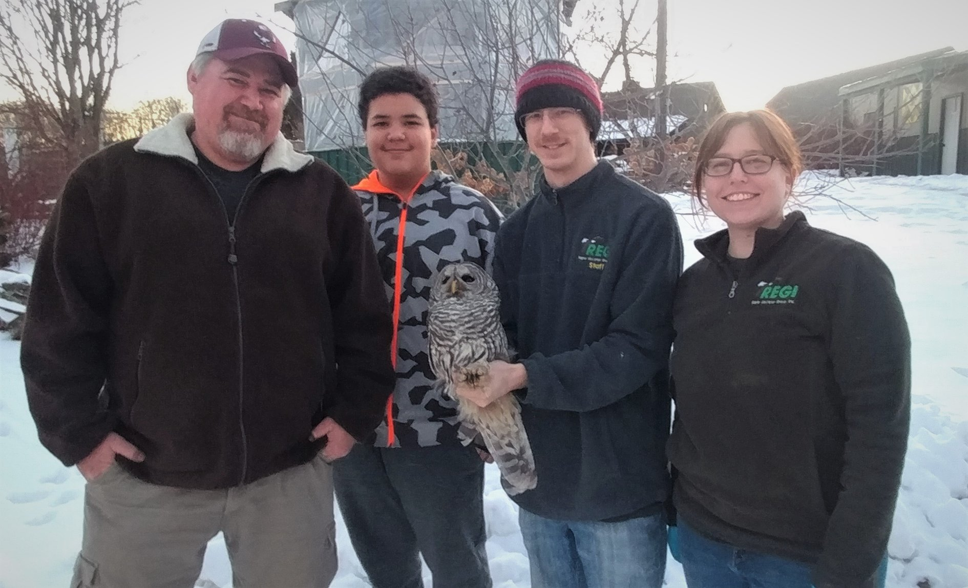 Danny Uran and his son Owen Uran with Avian Technician Greg Russ and Wildlife Rehabilitator/Clinic Manager Ashley Nilsson.