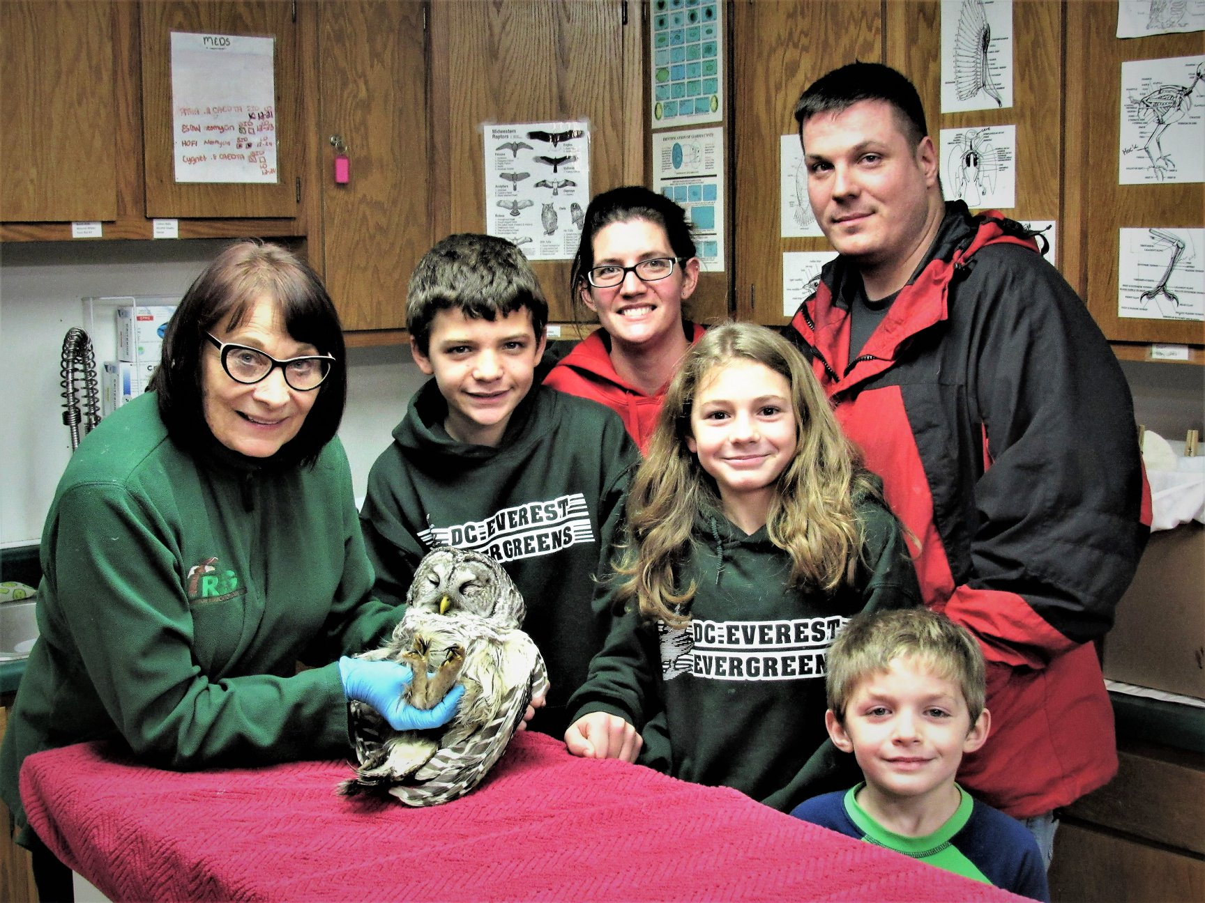 The Henle Family with the Barred Owl they saved.