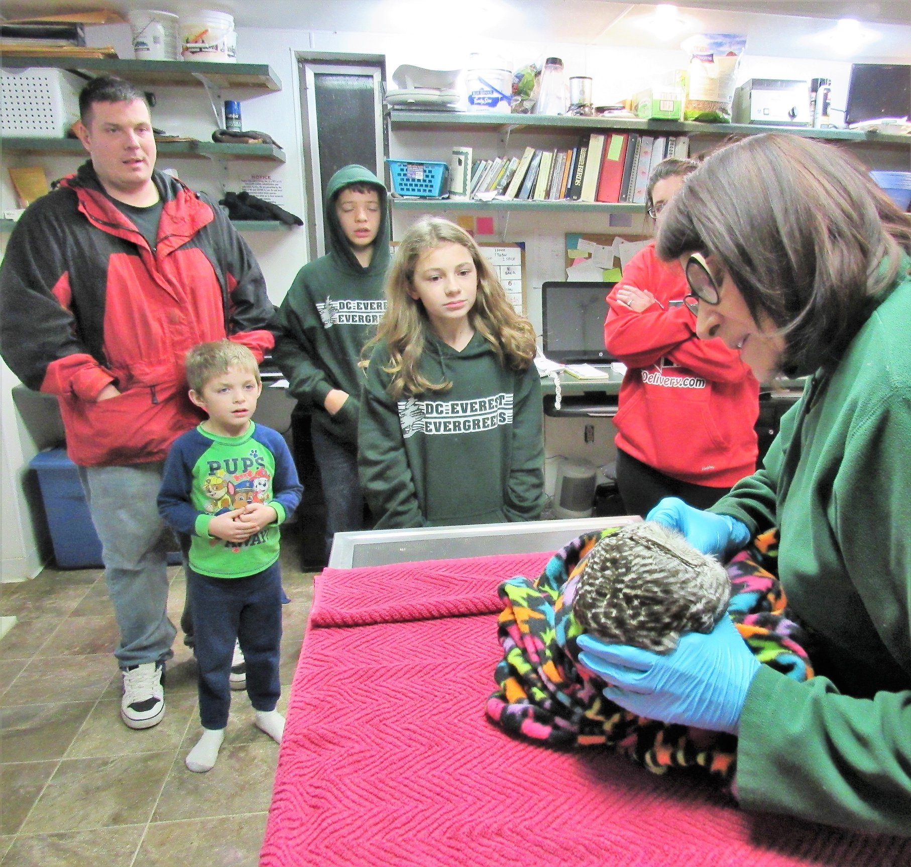 A huge part of our work at REGI is education. We love that our programs have touched this family. Here they observe the admission exam of the owl the rescued.