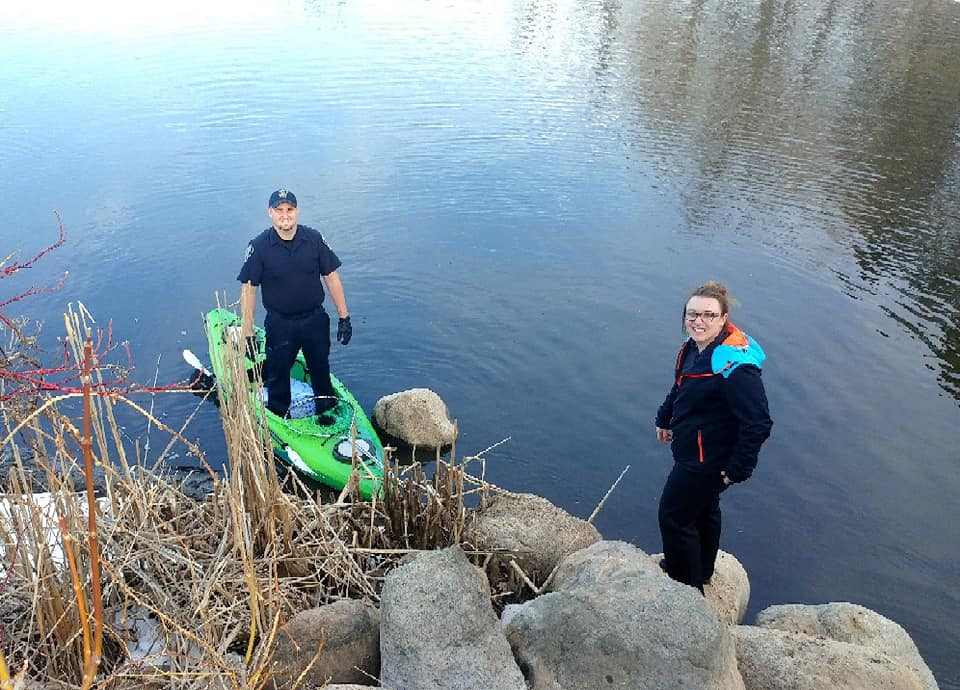Mission  accomplished! Patrolman Kyle Schilling and Dispatcher Lindsey Steger  happy the grebe escaped the entanglement after getting encouragement  from the police.