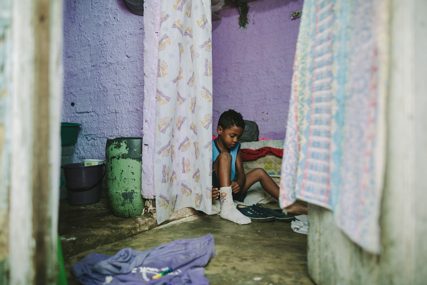 Emidio's entire house (housing 4 people---soon to be 5) is perhaps no larger than 8 feet by 10 feet. This is Emidio's morning routine before heading to classes at the Compassion Center.