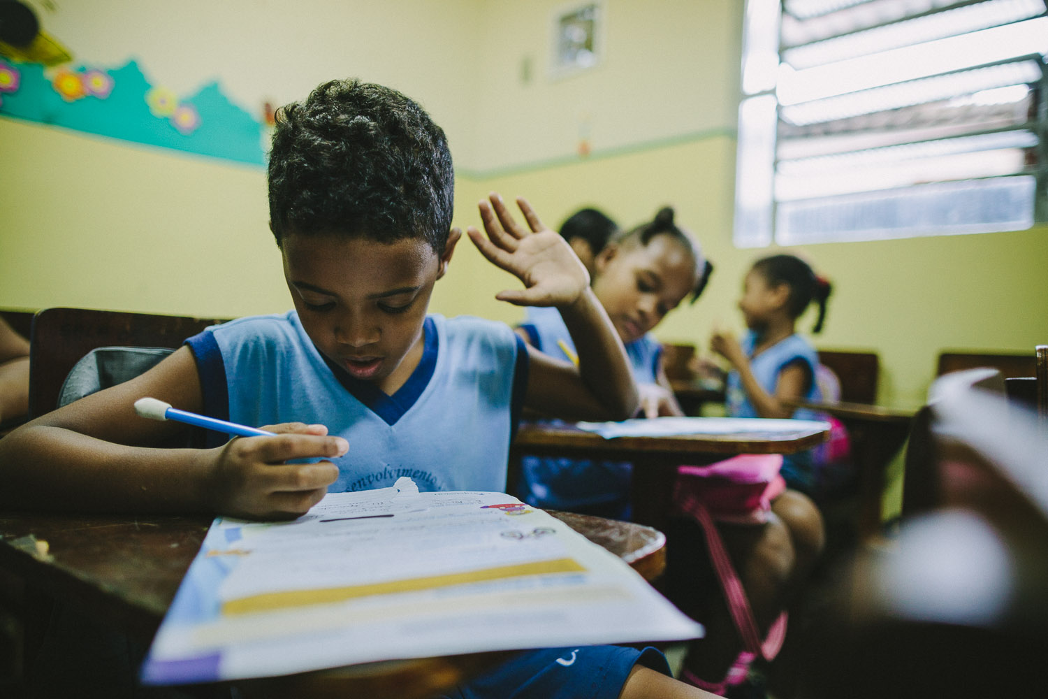 Emidio enjoys learning and is often seen asking the teacher for help and clarification. Emidio during classes at the Compassion Center.
