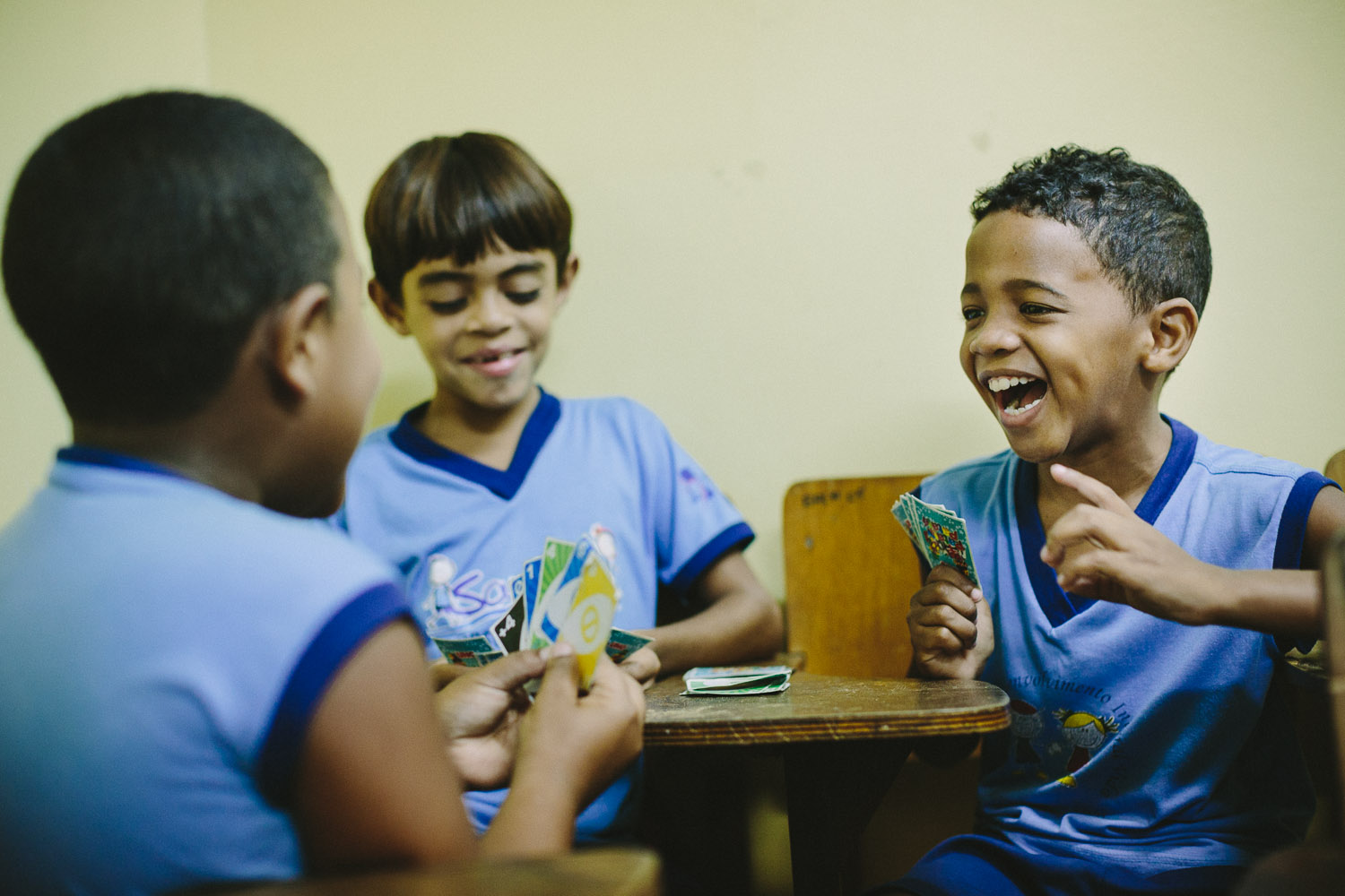 During free classroom time, Emidio enjoys playing Uno with his friends. Emidio during classes at the Compassion Center.