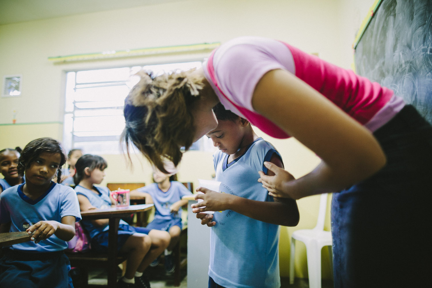 Like kids all over the world, Emidio doens't like to lose at games. The teacher comforts Emidio when she sees him pouting after losing a class game. Emidio during classes at the Compassion Center.