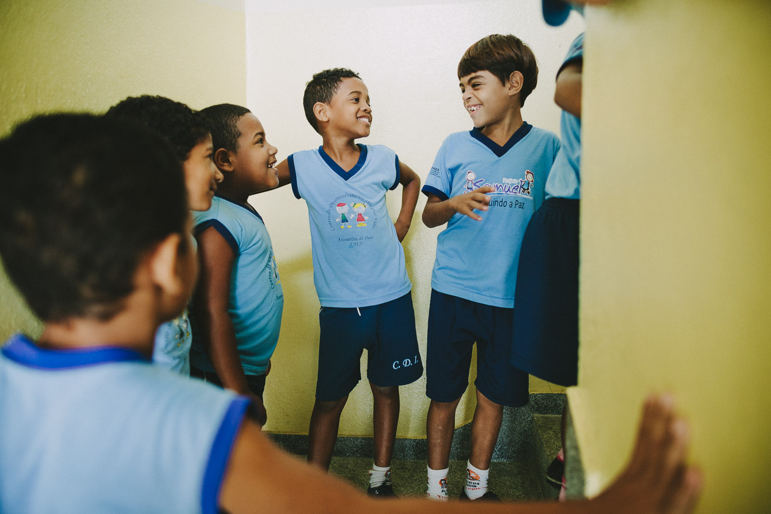 """Emidio and his friends discuss being excited about taking a small """"fieldtrip"""" to another room for story time. Emidio during classes at the Compassion Center."""