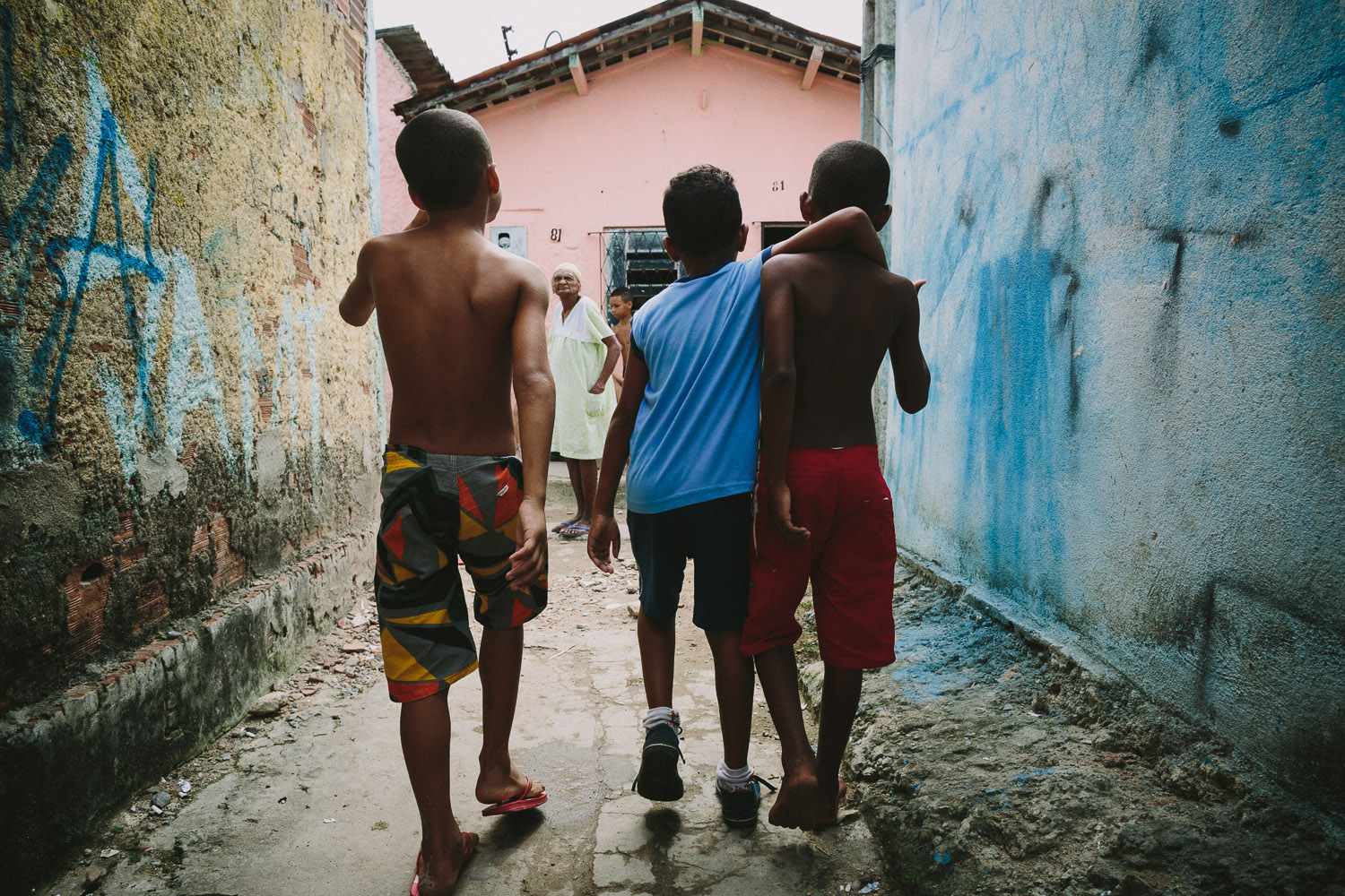 """Emidio is join by a friend on his walk back from the Compassion Center. After his time at the Compassion Center, Emidio walks to his """"aunt's"""" house (family friend---no relation) to be taken care of before heading to school since his mother works until 10pm each night."""