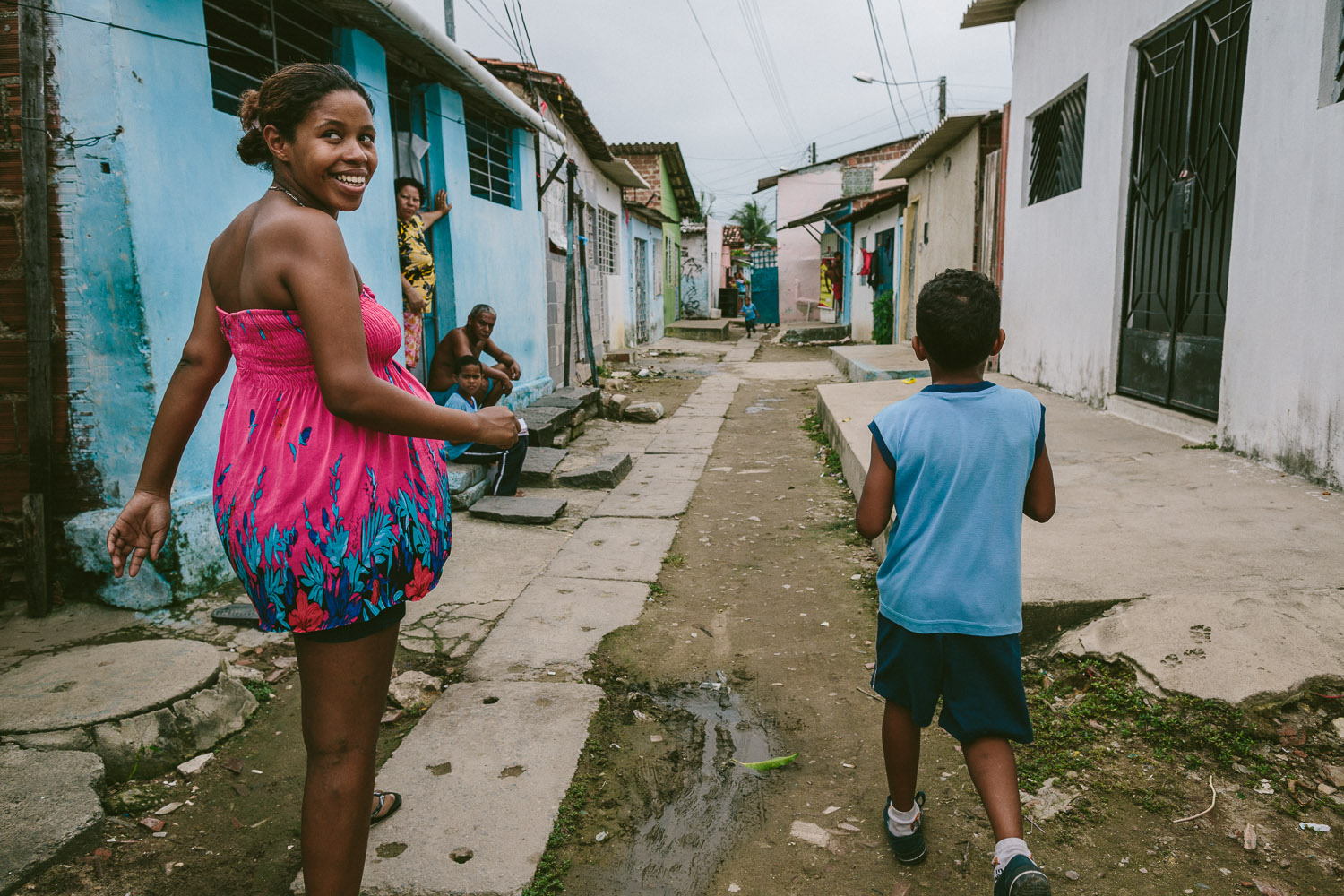 """Before heading to his mother's friends house, Emidio's mother joins him for a bit before heading to her job. After his time at the Compassion Center, Emidio walks to his """"aunt's"""" house (family friend---no relation) to be taken care of before heading to school since his mother works until 10pm each night."""
