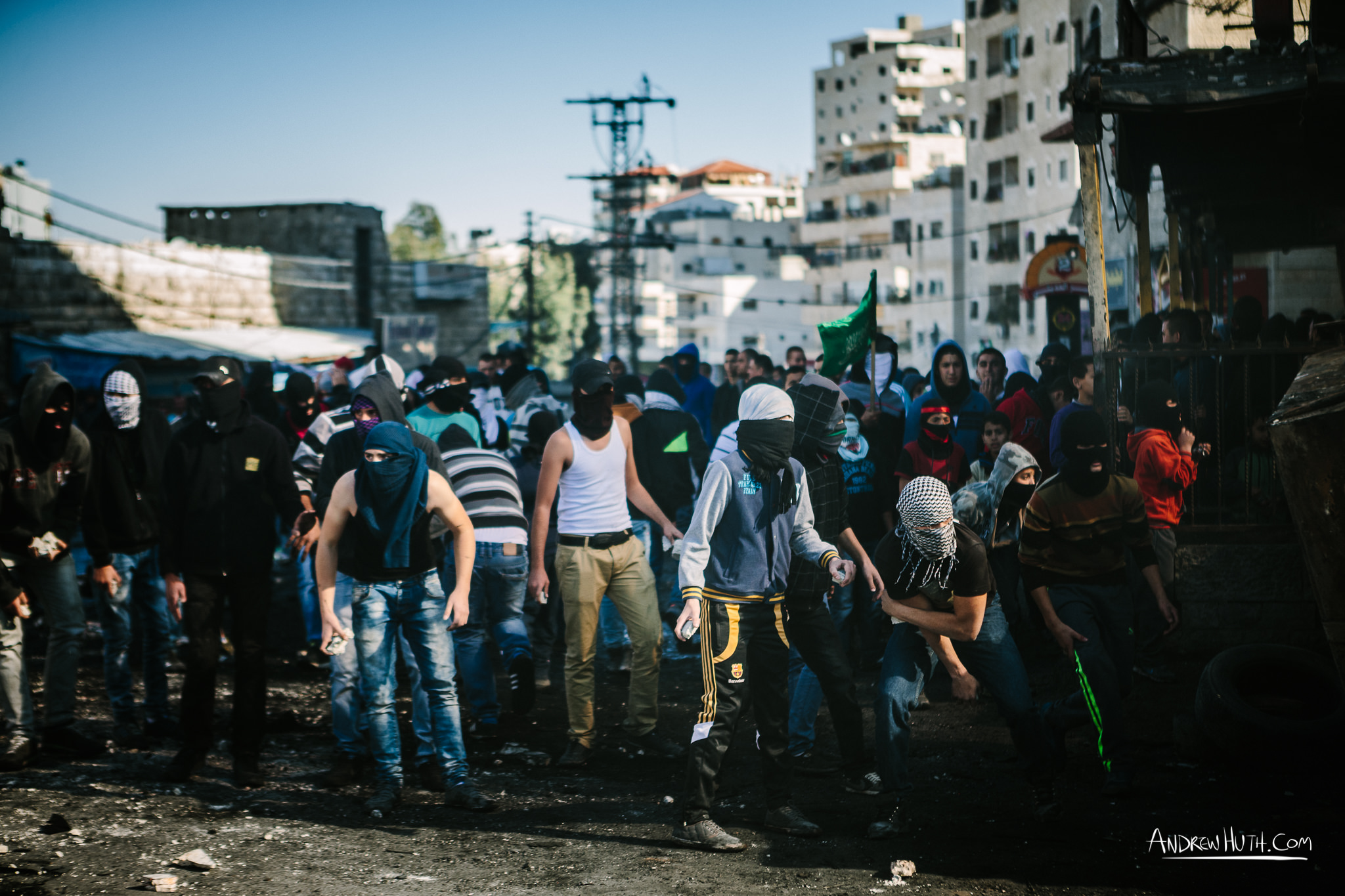 Palestinian youth clash with Israeli military in Shu'afat Refugee Camp in East Jerusalem on Friday, November 7, 2014. The recent, but temporarily total closure of one of Muslim's holiest sites, the Al-Aqsa Mosque, (the first since 1967) and the subsequent limited access for many Muslims to the mosque since has raised tension between Israeli's military and the Arab community.