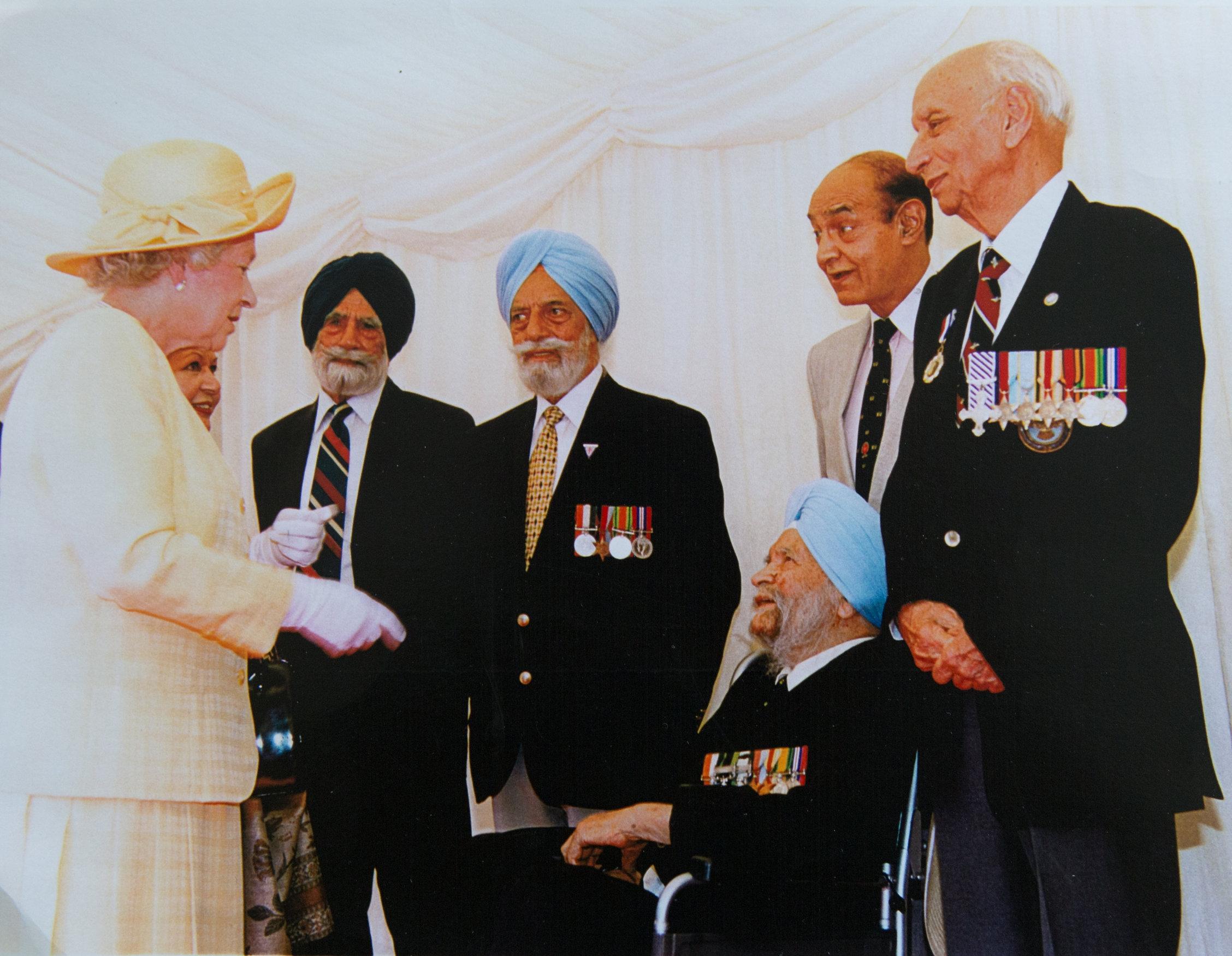 The Queen meets heroes