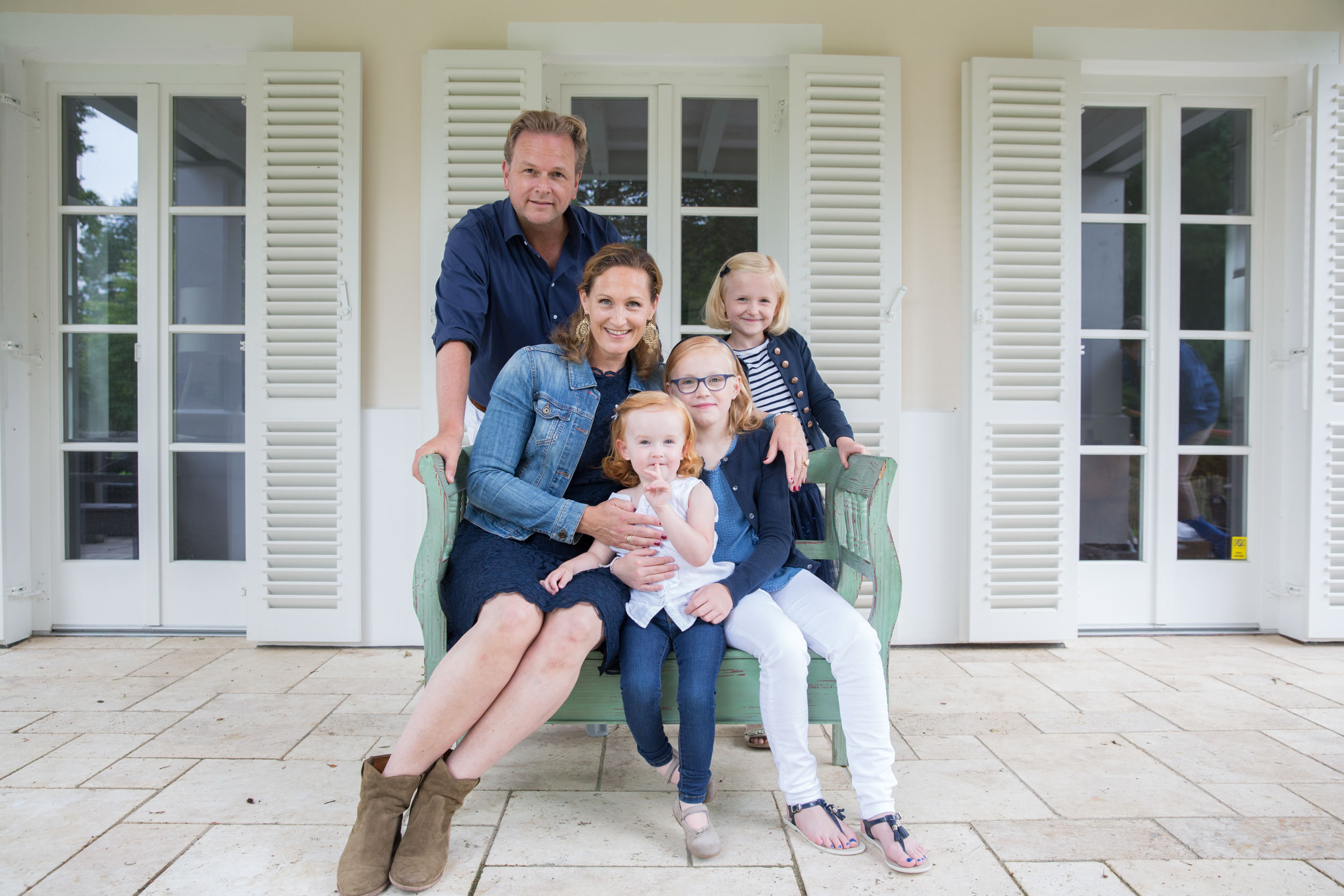 Alice photographed with her adorable 3 young daughters in Starnberg south of Munich by Charlotte Starup at her home. The photo is printed in 70 times 100 and hanging on a brick wall with modern lamps.