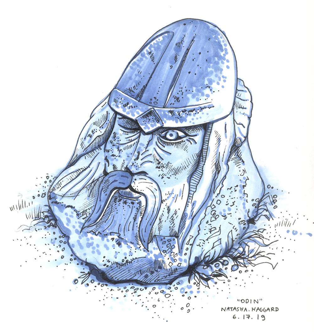 A stone statue of Odin's head