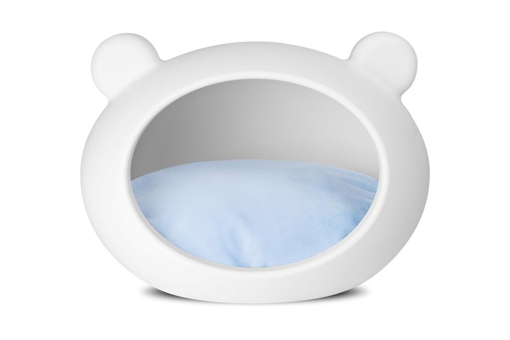 white_dog_cave_blue_cushion.jpg