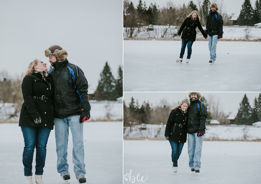 couple skating on outdoor pond in winter