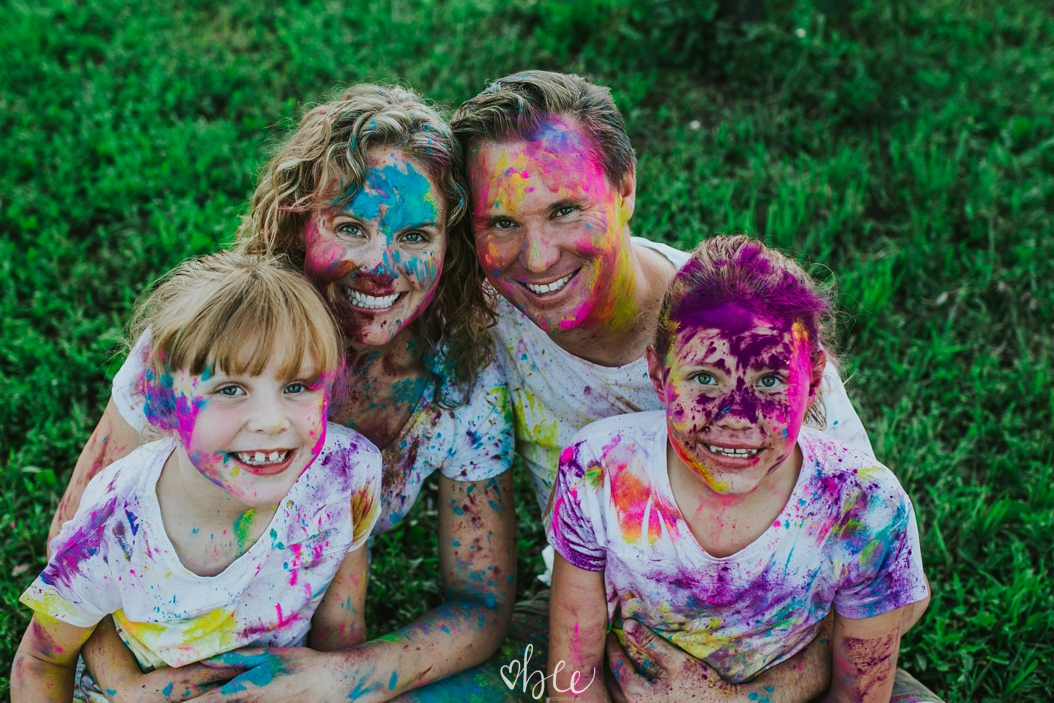 family covered in HOli Powder