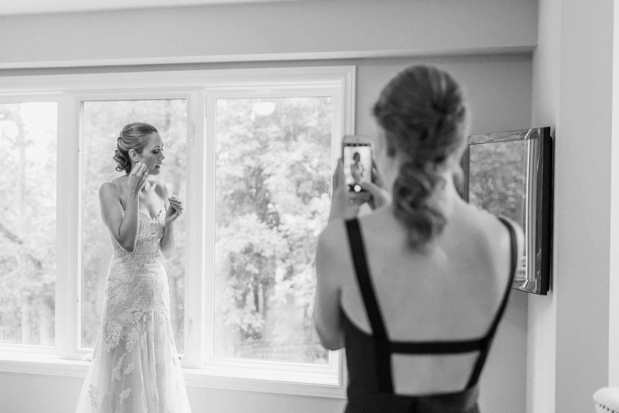 Bride putting on earrings before wedding