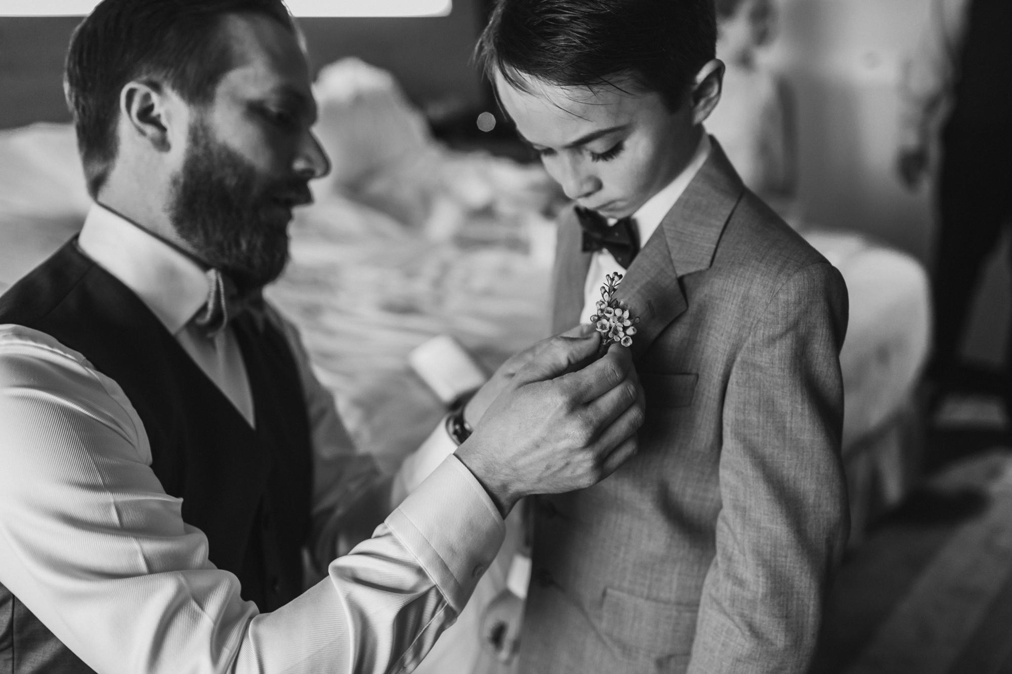 Helping his nephew get dressed up