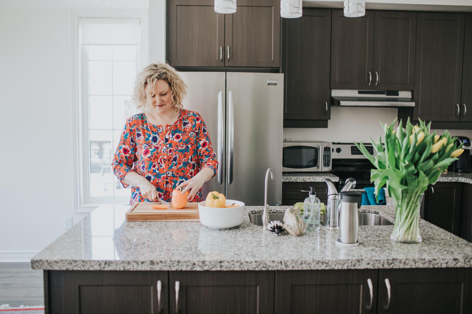 woman-cooking-white-kitchen