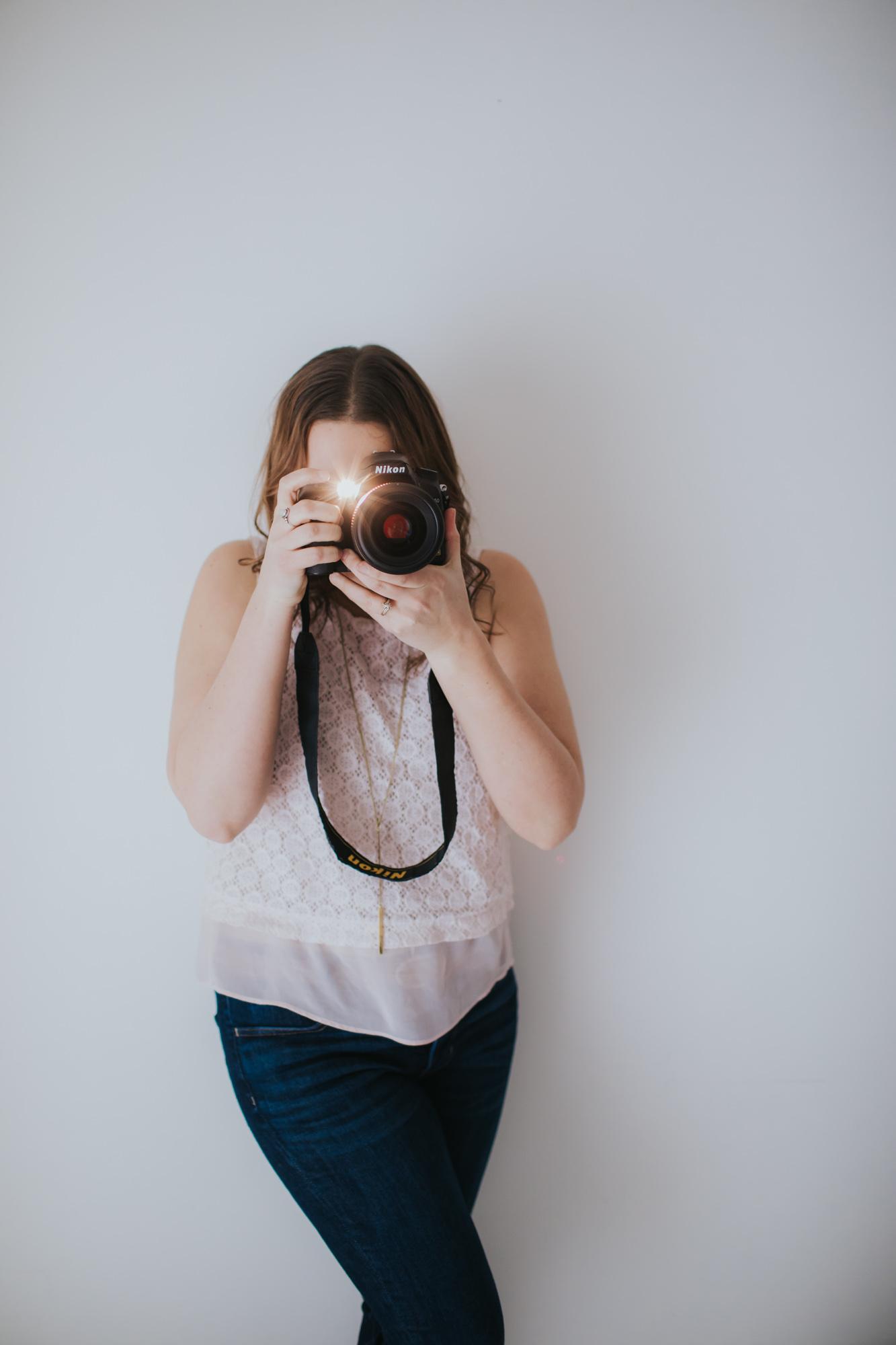 photographer-headshot-with-camera
