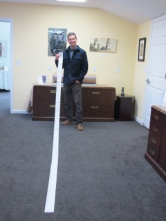 Project Coordinator Eric Rutledge with 2013's property tax receipt