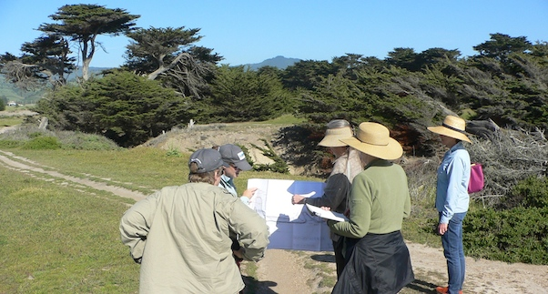 CLT Stewardship Volunteers and Executive Director Jo Chamberlain review trail plans