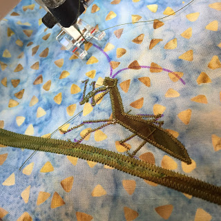 A look behind the scenes ... Stitching a favorite detail, the preying mantis.