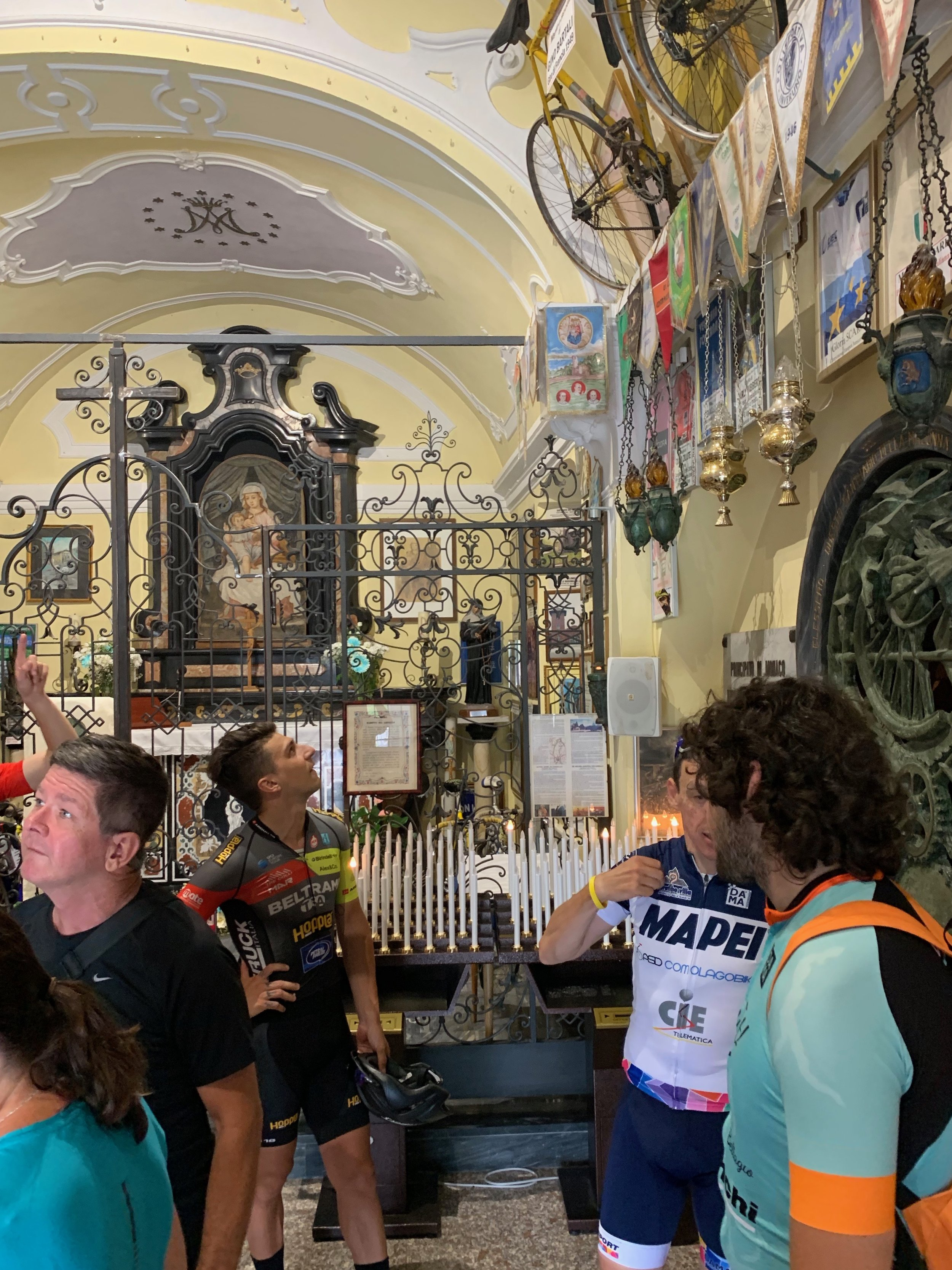 We biked to the Madonna del Ghisallo chapel/shrine. According to legend count Ghisallo was traveling when he was attacked by bandits. He saw an image of the Virgin Mary at a shrine, ran to it and was saved from the robbers. In later times the the area became part of the two largest Italian cycling races and became a natural stopping point for cyclists. An eternal flame burns here for cyclists who have died.   Inspiration take away  — Respect for the way devotion, tribute and remembering can come in many forms.