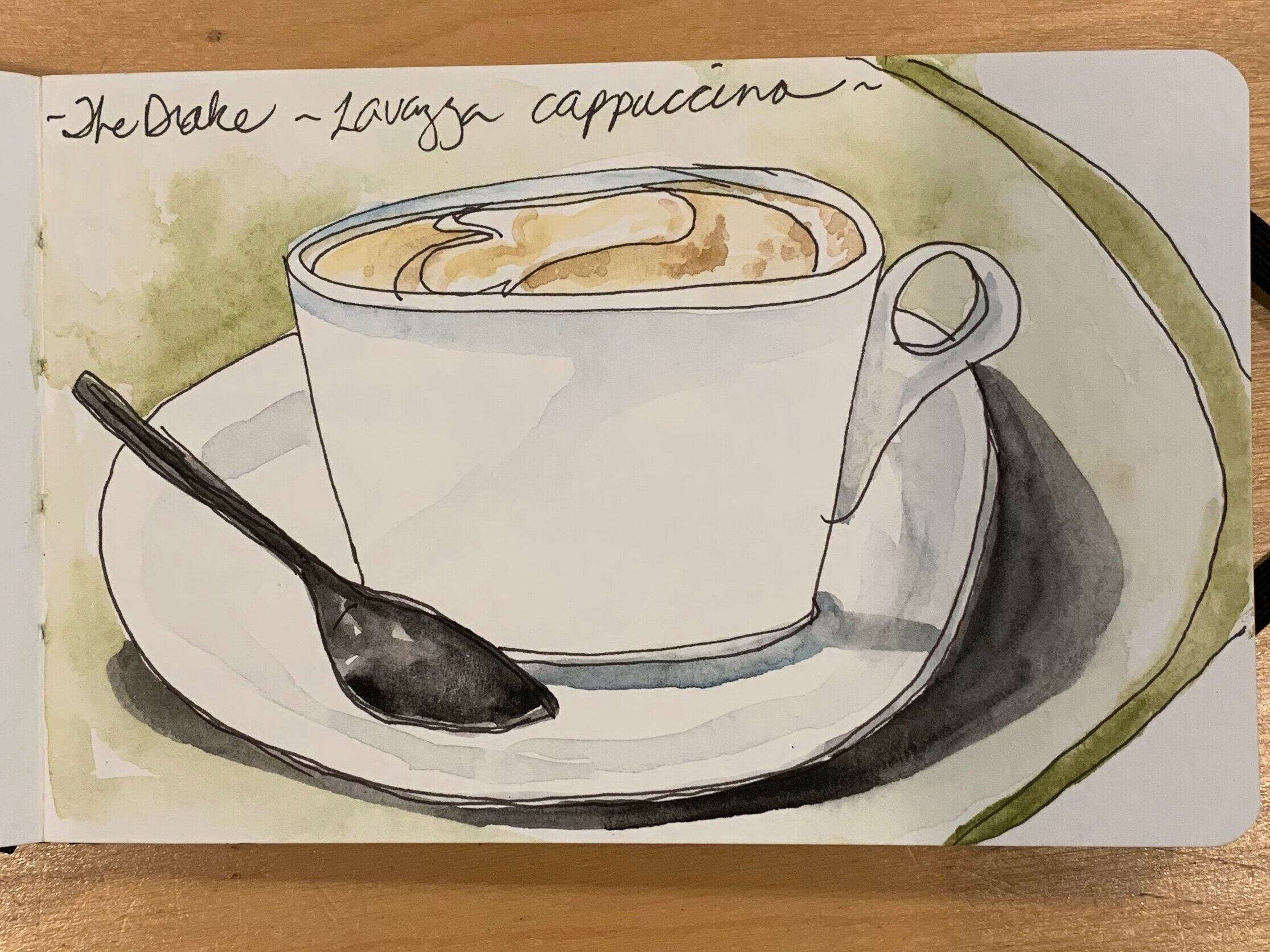"The start of a new day — I drink plain black coffee in the studio but on the road a cappuccino is a real treat. This cup rejuvenated me and let me ponder what I'd seen int eht ""resurrection' exhibit at the contemporary art museum."