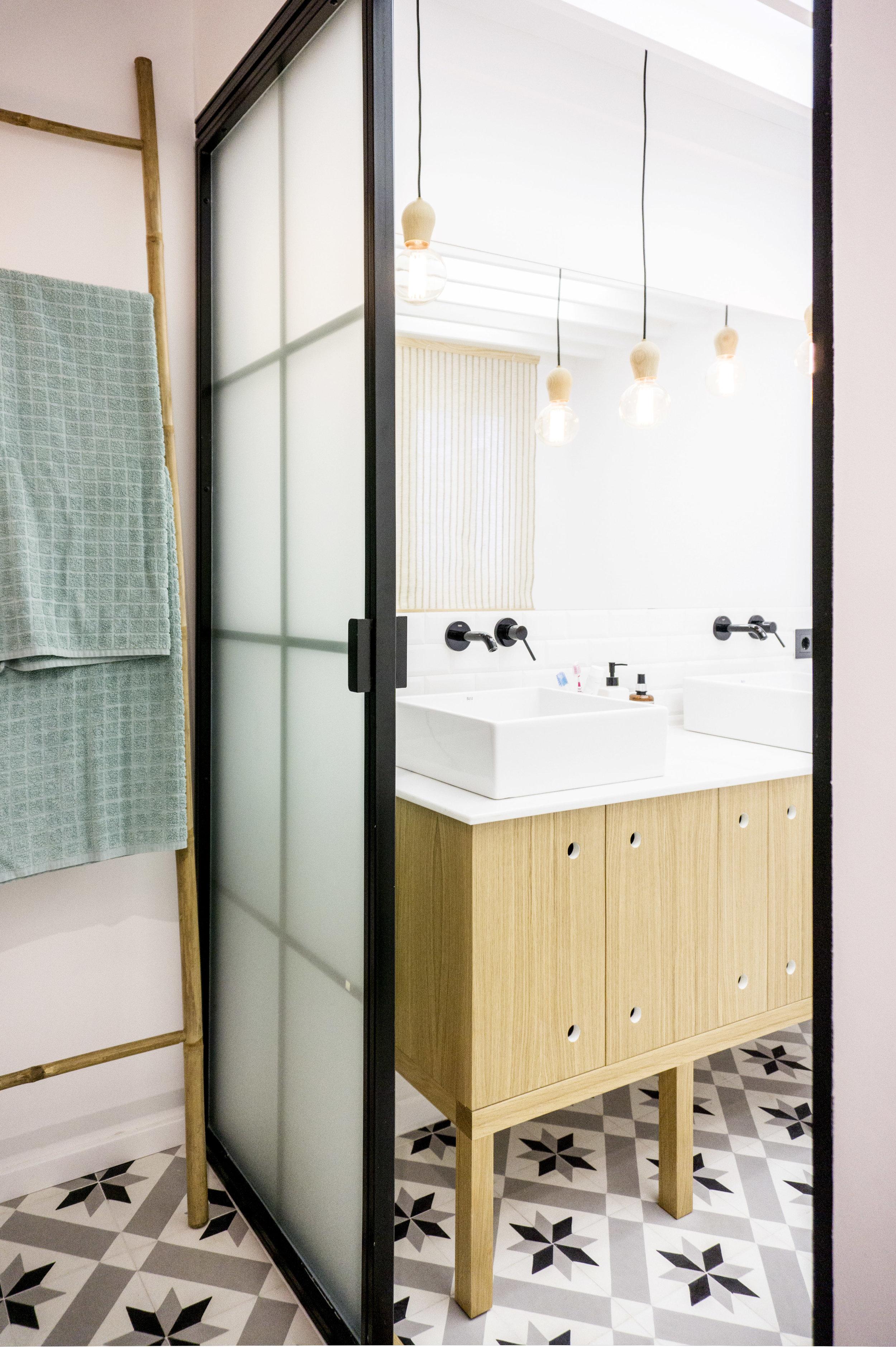 emmme studio AD detalle baño principal el hogar de Laura y Pedro.jpg