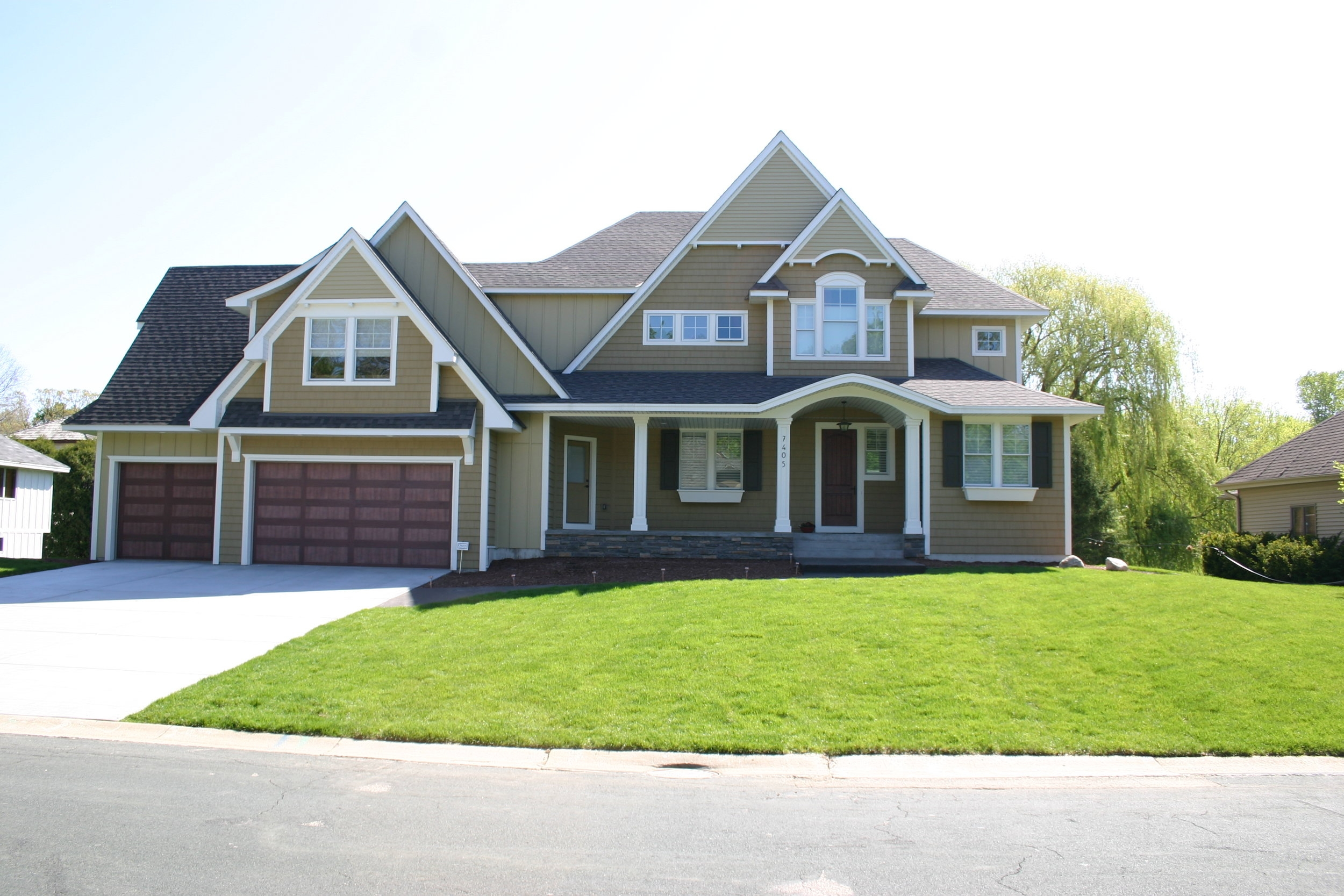 Before: Without any landscaping, this suburban home is adrift in endless turfgrass.
