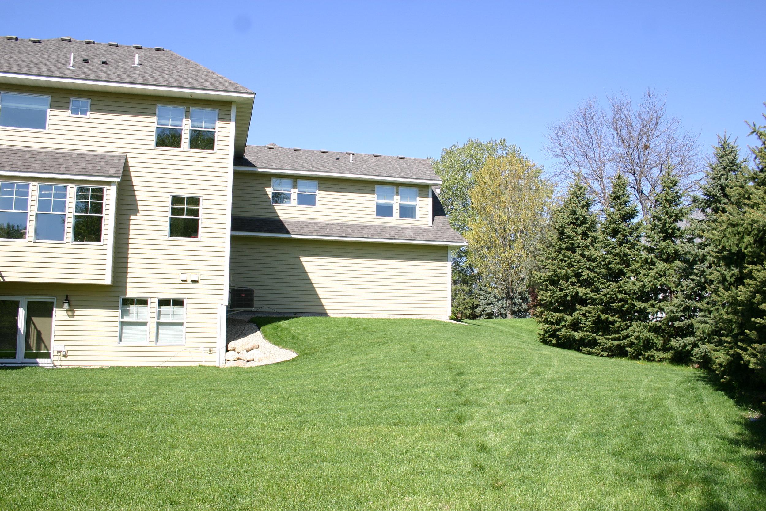 Before: Sharp angles and tall corners dominate the backyard.