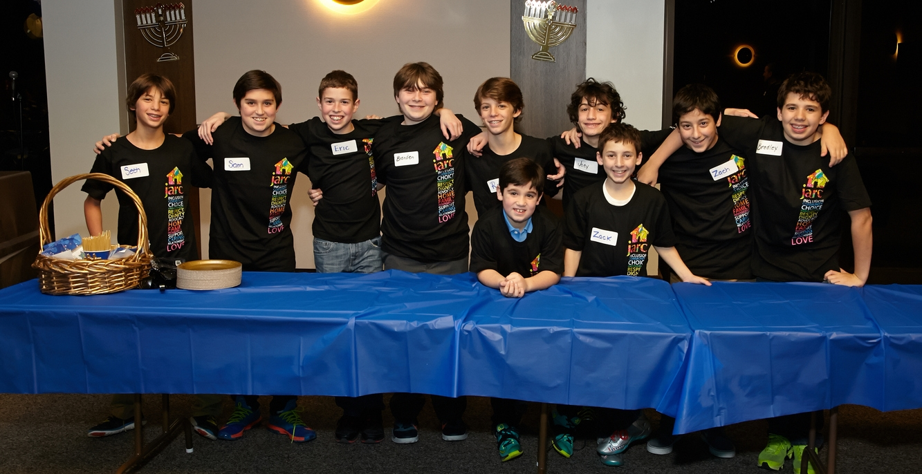 Youth volunteers helping out at the 2014 ILS Hanukkah Party!