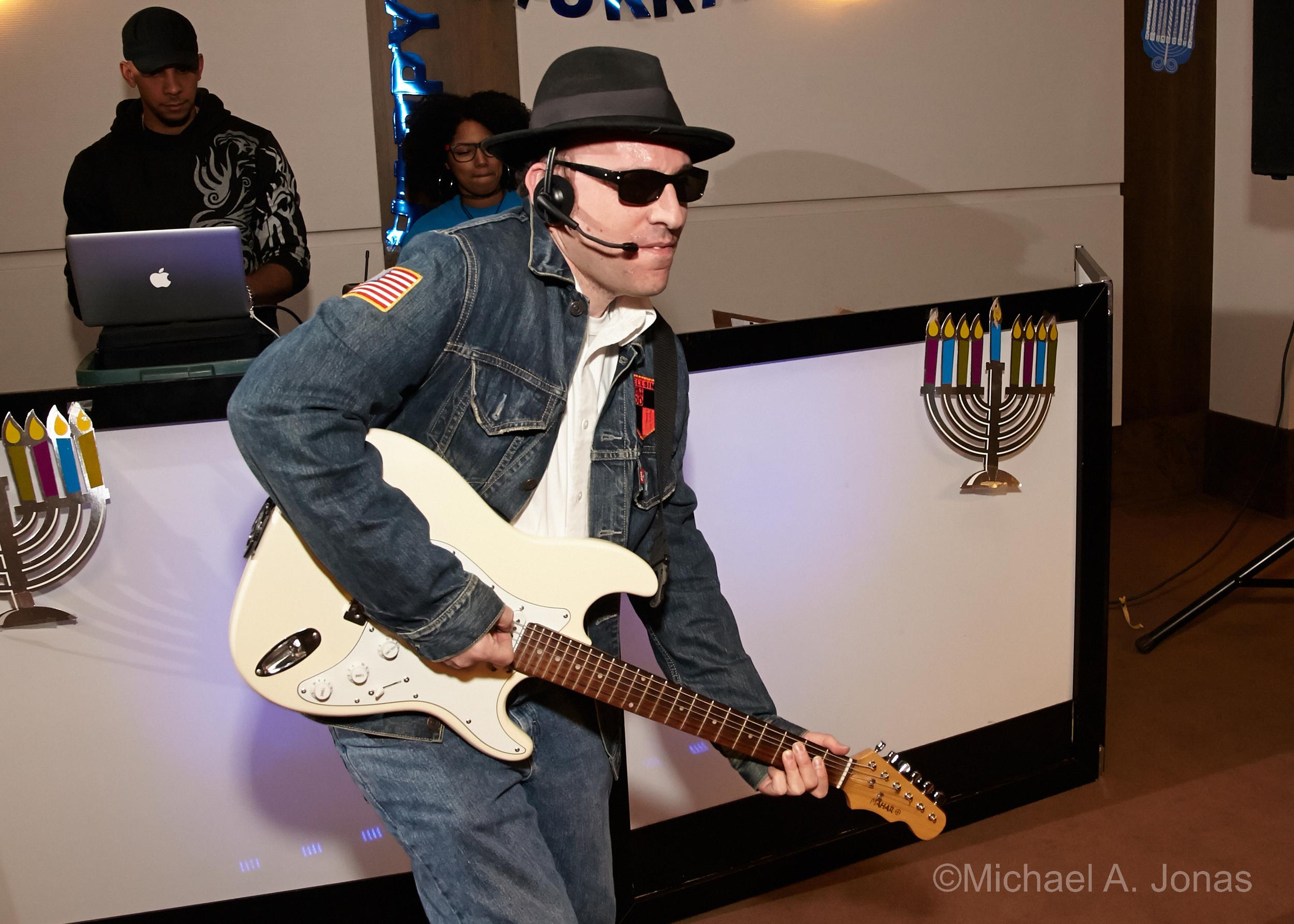Adam rocking out at JARC's annual ILS Hanukkah Party