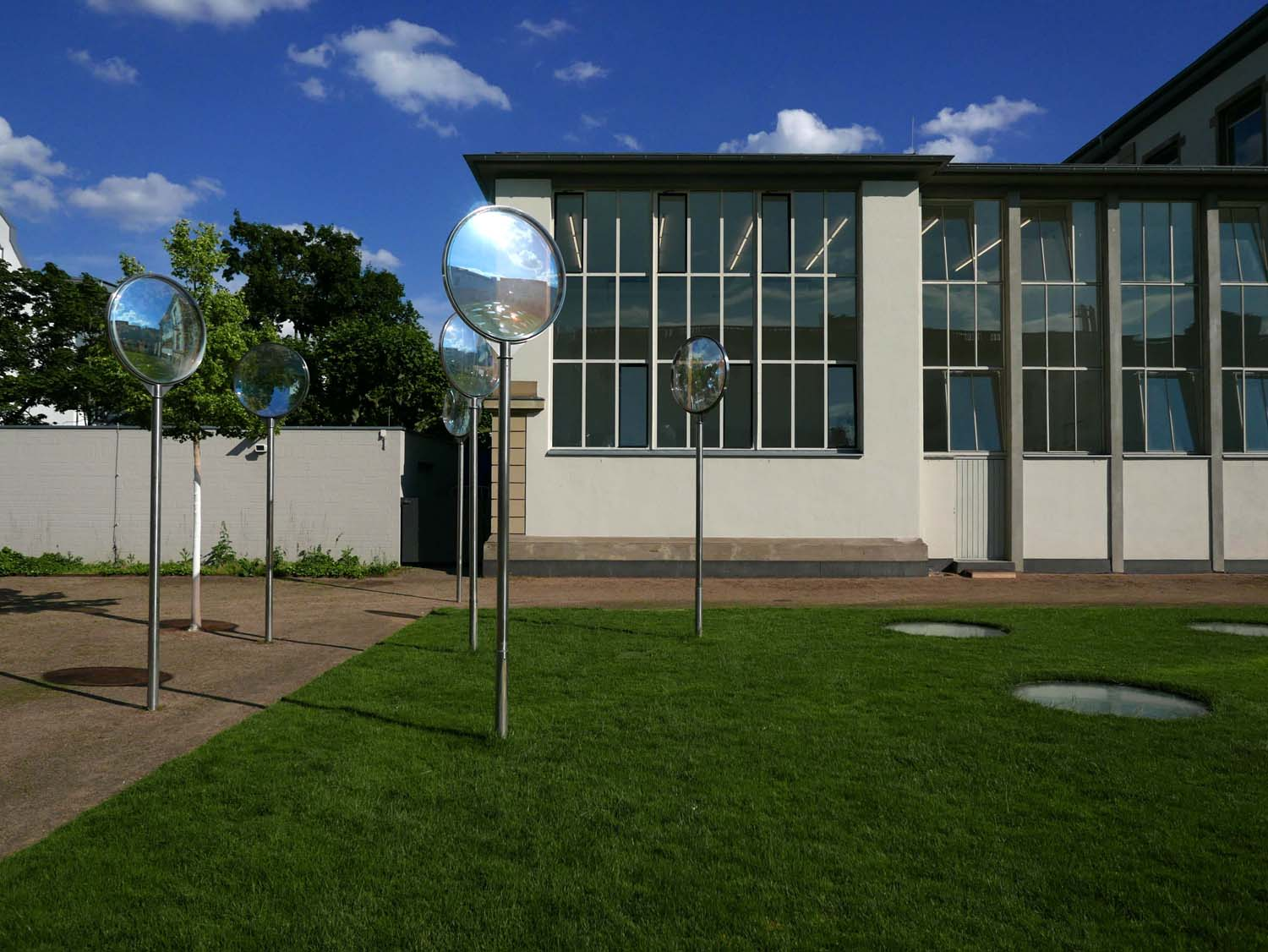 Part of the Städelschule (Städel art school) with the skylights of the contemporary galleries visible in the grass