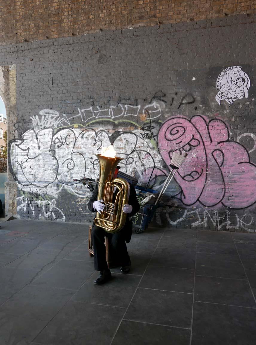 Street musician blowing fire