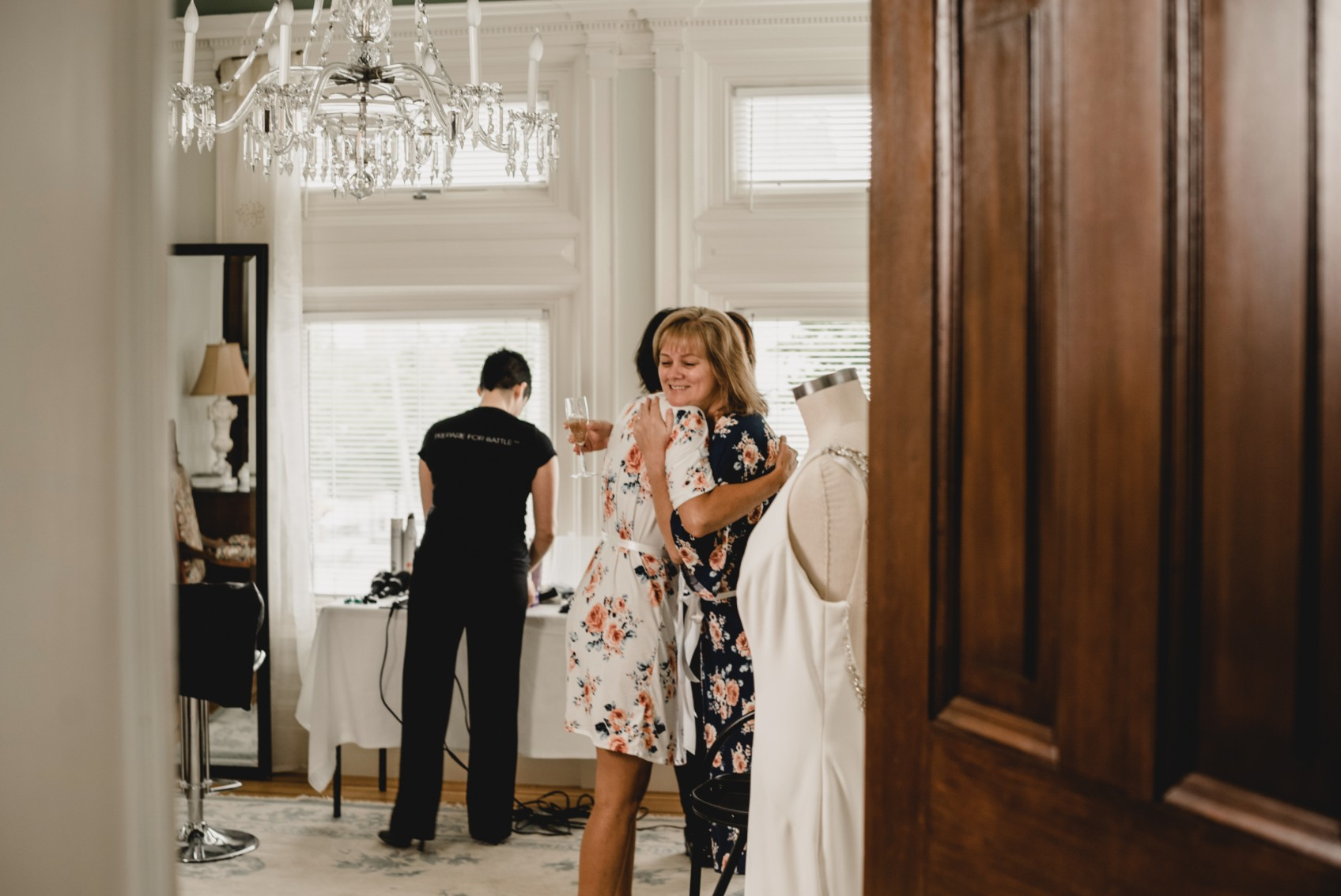 """9:30 AM The bride receives her wedding dress from """"mom""""."""