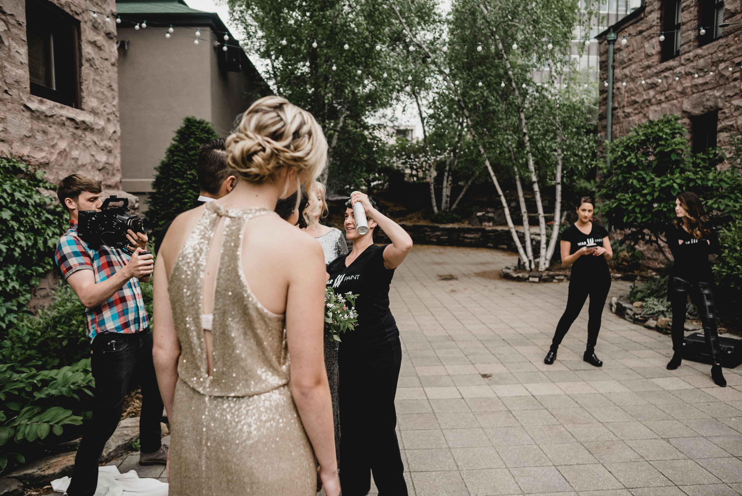 The WarPaint team gives one last final touch to the wedding party.