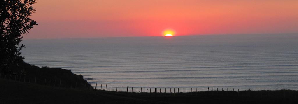 Sunset from Cbarn accommodation, Ngarunui beach, Raglan.