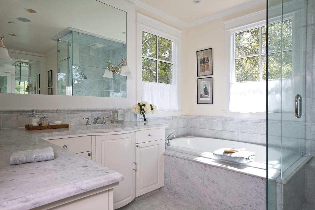 Bright and airy Carrera Marble Master Bath