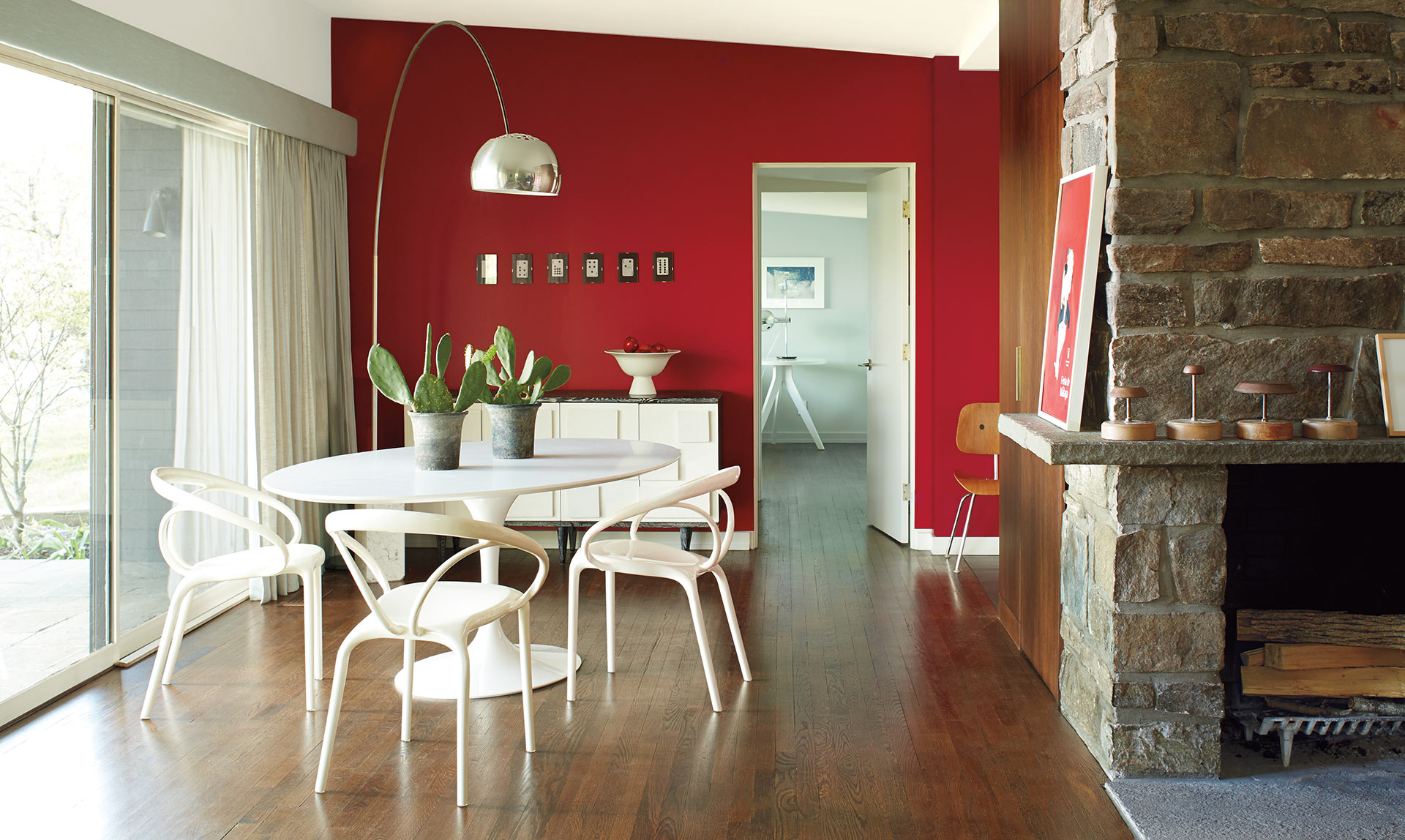 THE PURE LINES and crisp geometry of a modern home find their playful side in lighthearted reds and pinks that bring minimalism to life.