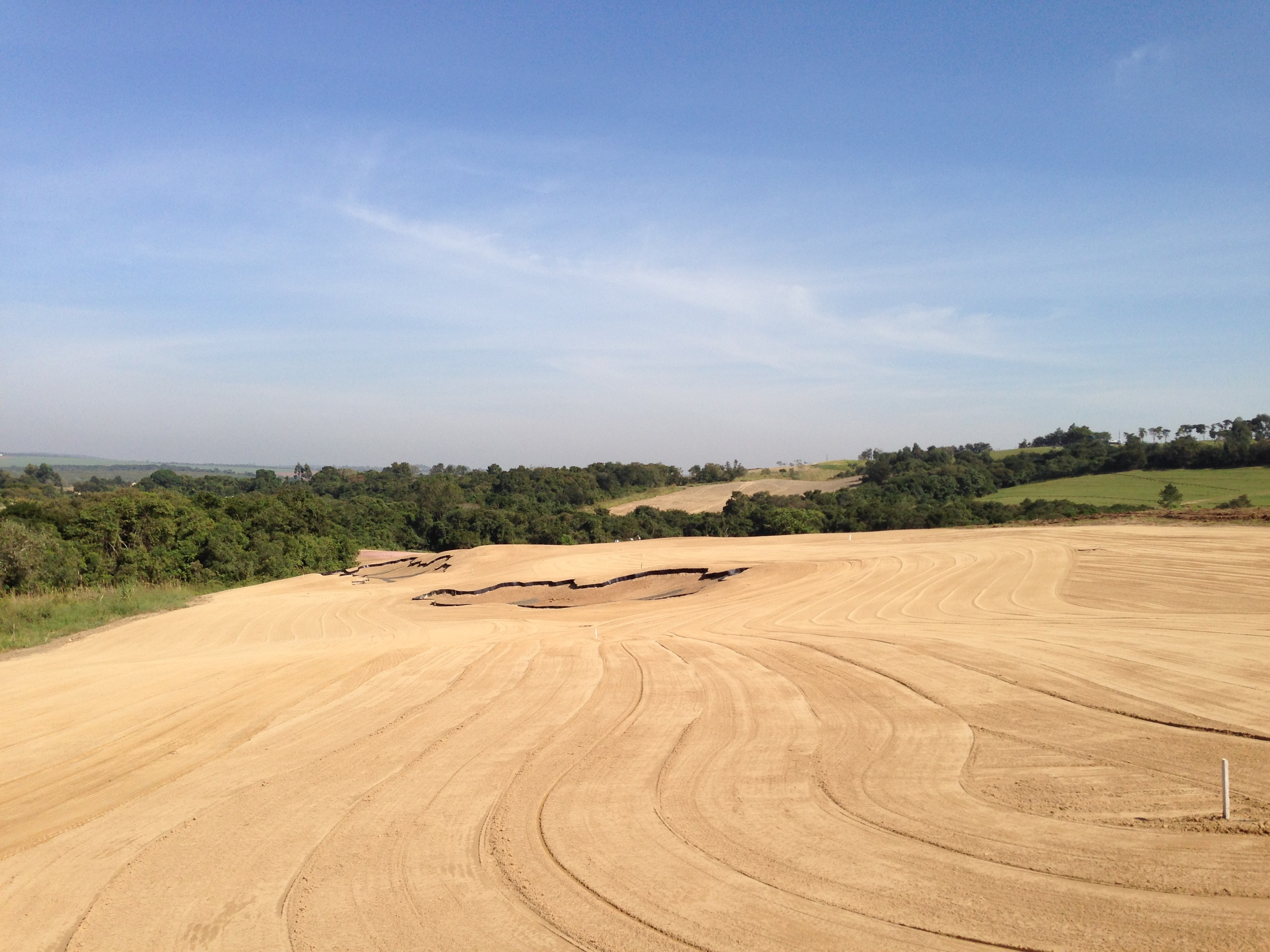 "Hole 15 fairway after edits.  The foreground bunker was extended left and made to look like it is sweeping more down the hillside.  The bunker in the far ground had the squiggly-ness of the low left side both toned down and outer points adjusted to create a ""connect the dots"" curve."