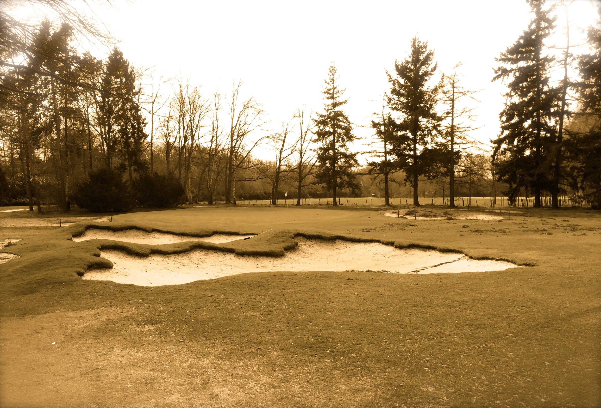 The 2nd hole bunkers close up with antique filtering for effect.  Another benefit of bunkers in close proximity is that the look and relation of the two constantly changes as one moves closer and around them.