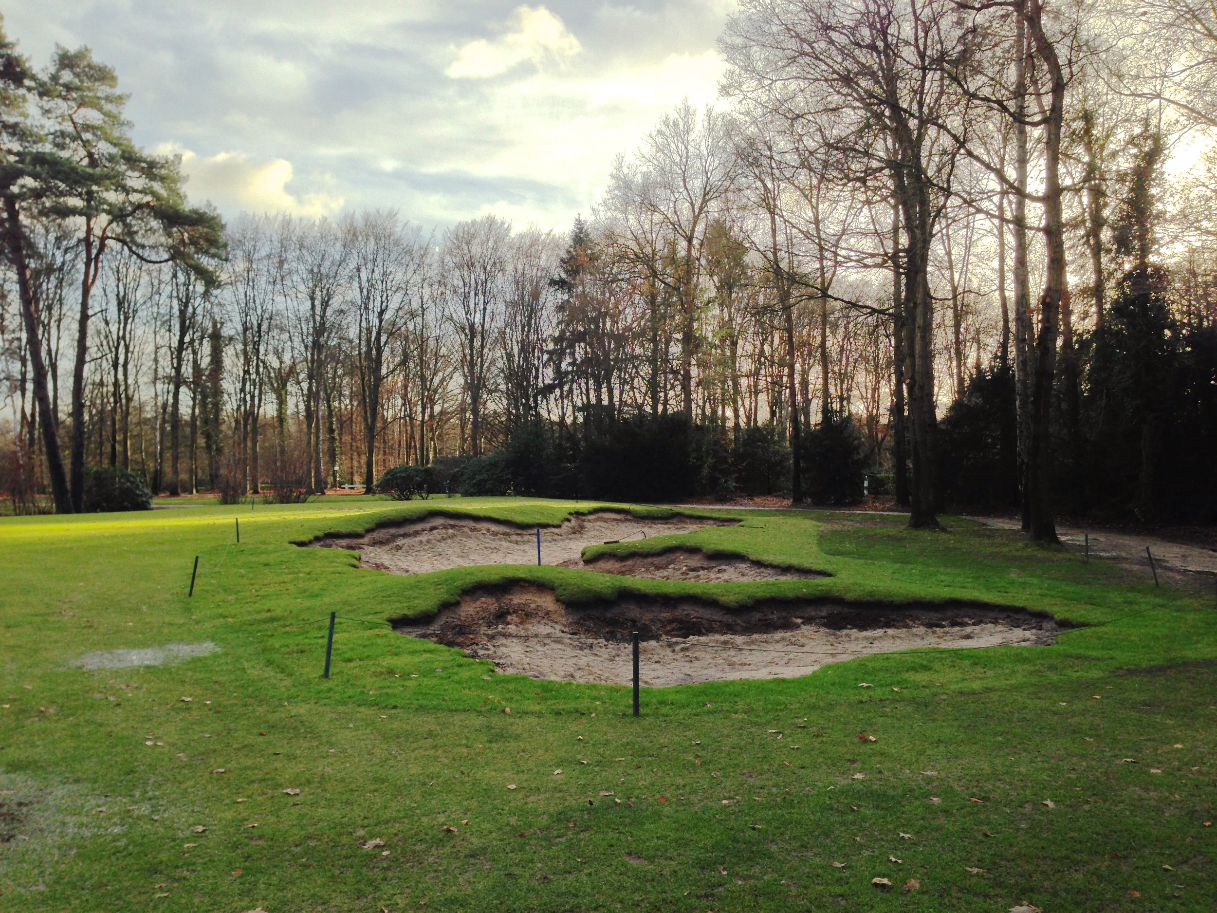 A close up of the 9th hole bunker just after the final sod cut back in December.  Here you can see that it is indeed just two bunkers.