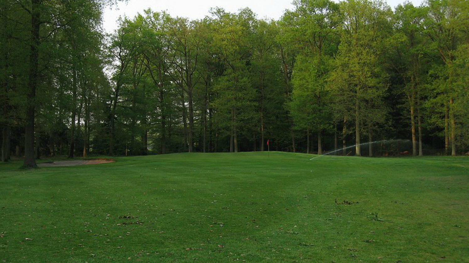 Hole 14 before. Hard to believe, but there is a bunker over there on the right.