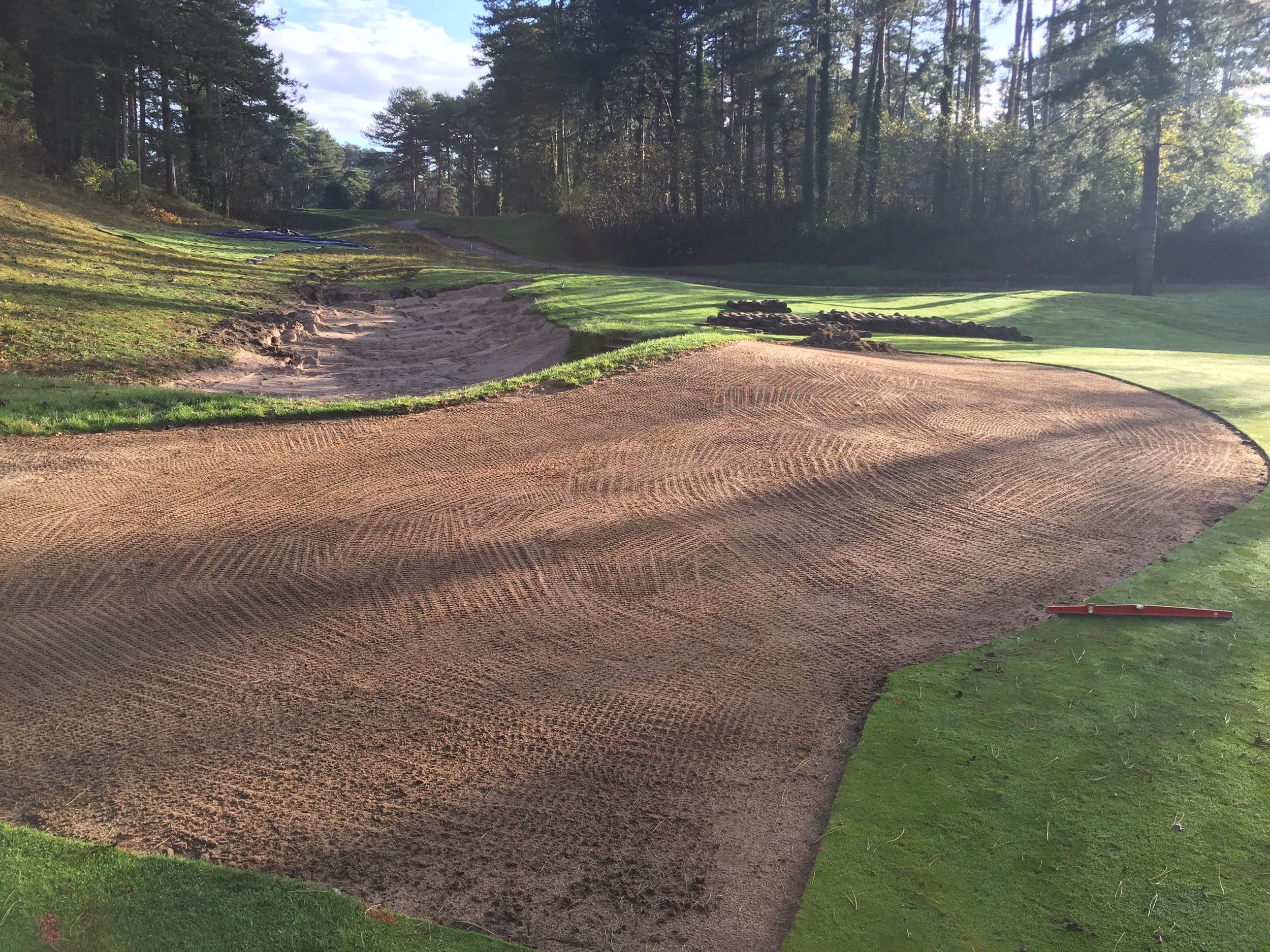 This is a softening and corner expansion of the front right corner of the short par 3 5th green at Les Pins. The bunker edge was simply collapsed using excavation underneath, meaning there was no need to rebuilt that edge in the soft blown-in beach sand.