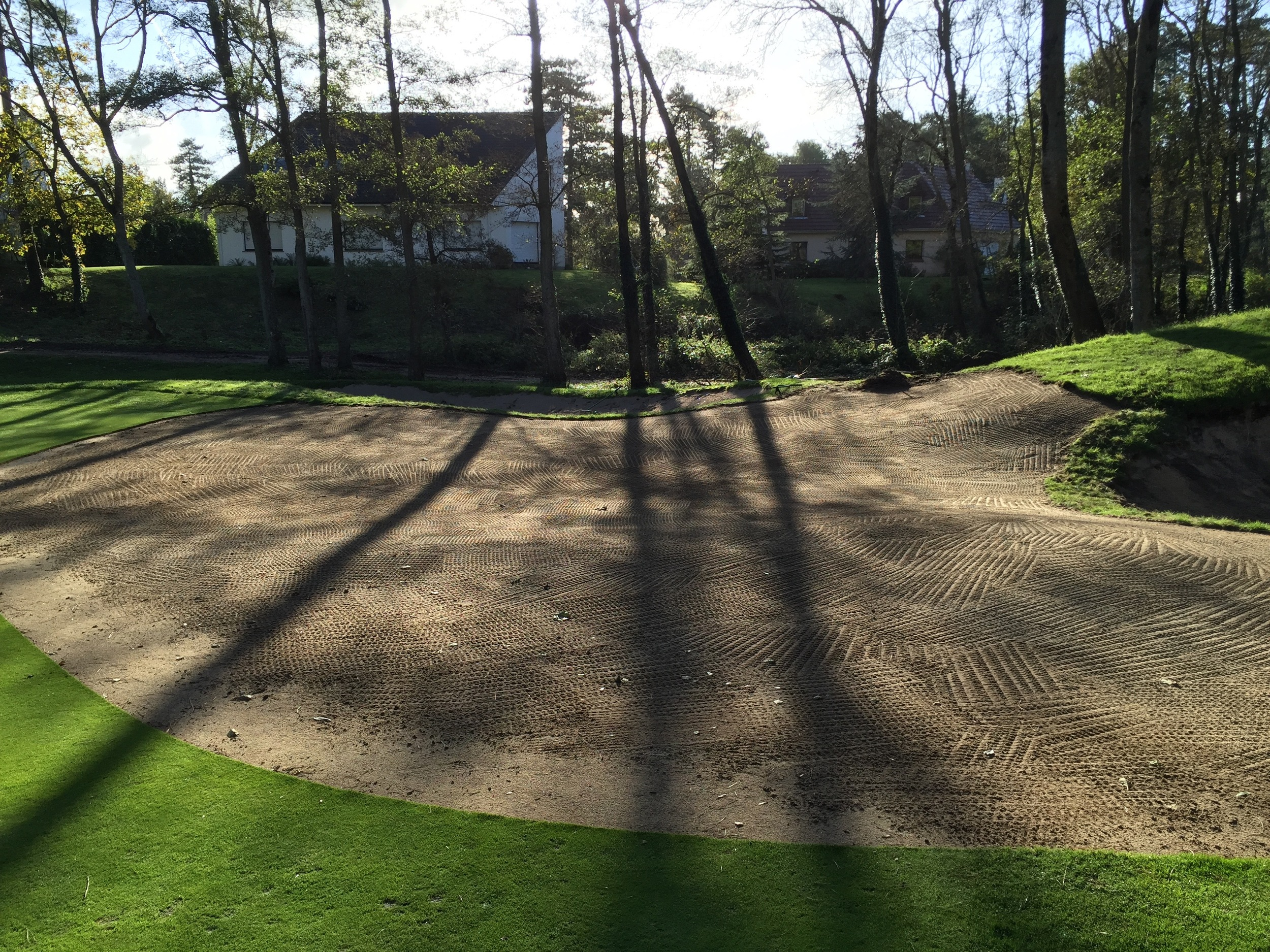 The back bunker on the 5th was reduced and the green expanded and edited to have two different high and low back pin placement. All shaping and handwork completed by Hochstein Design.